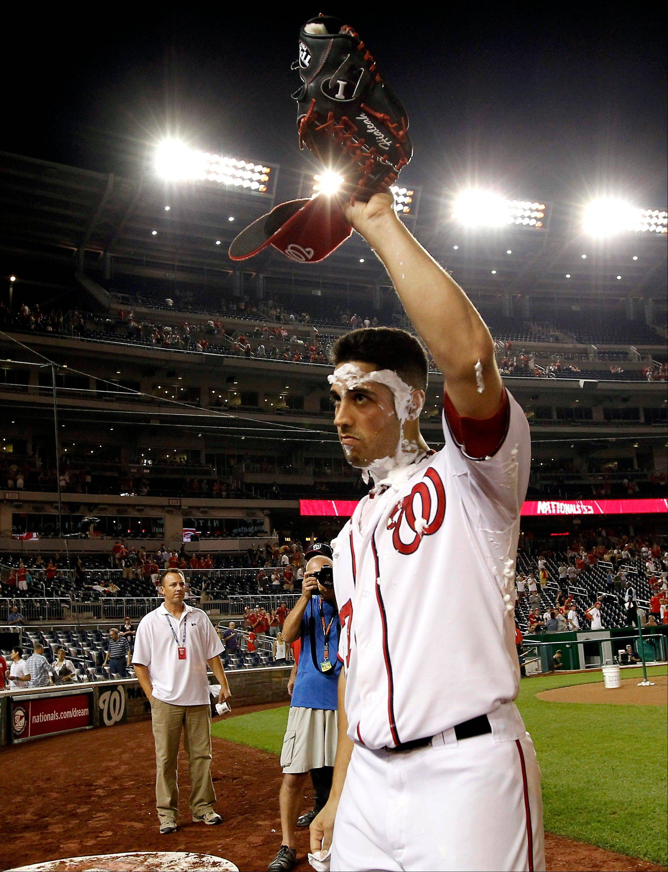 Washington Nationals starting pitcher Gio Gonzalez acknowledges the crowd after getting celebratory shaving cream smeared in his face. Gonzalez pitched a complete-game shutout Friday at home against the St. Louis Cardinals.