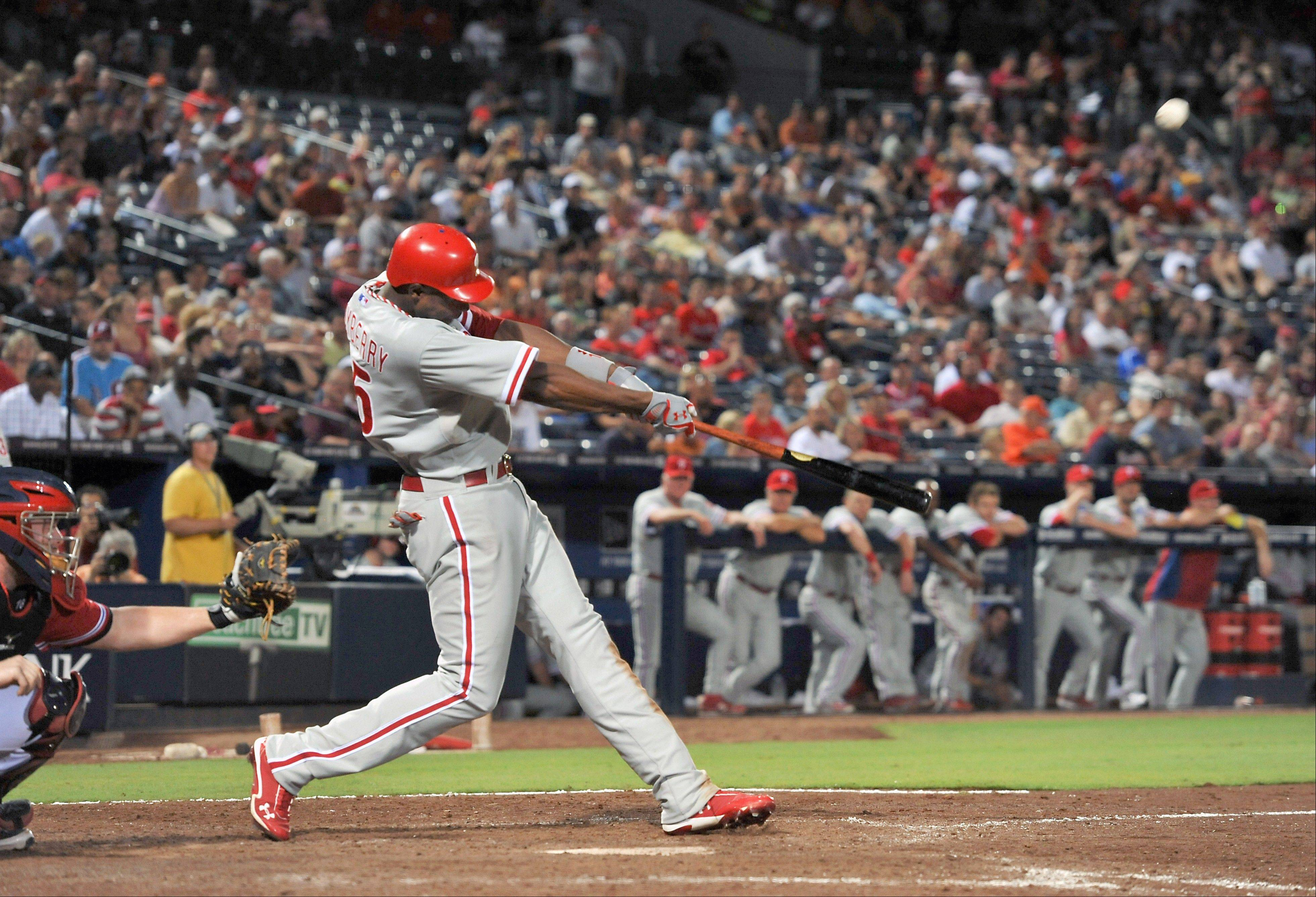 Philadelphia's John Mayberry connects on his go-ahead three-run home run against the Atlanta Braves during the 10th inning Friday in Atlanta.