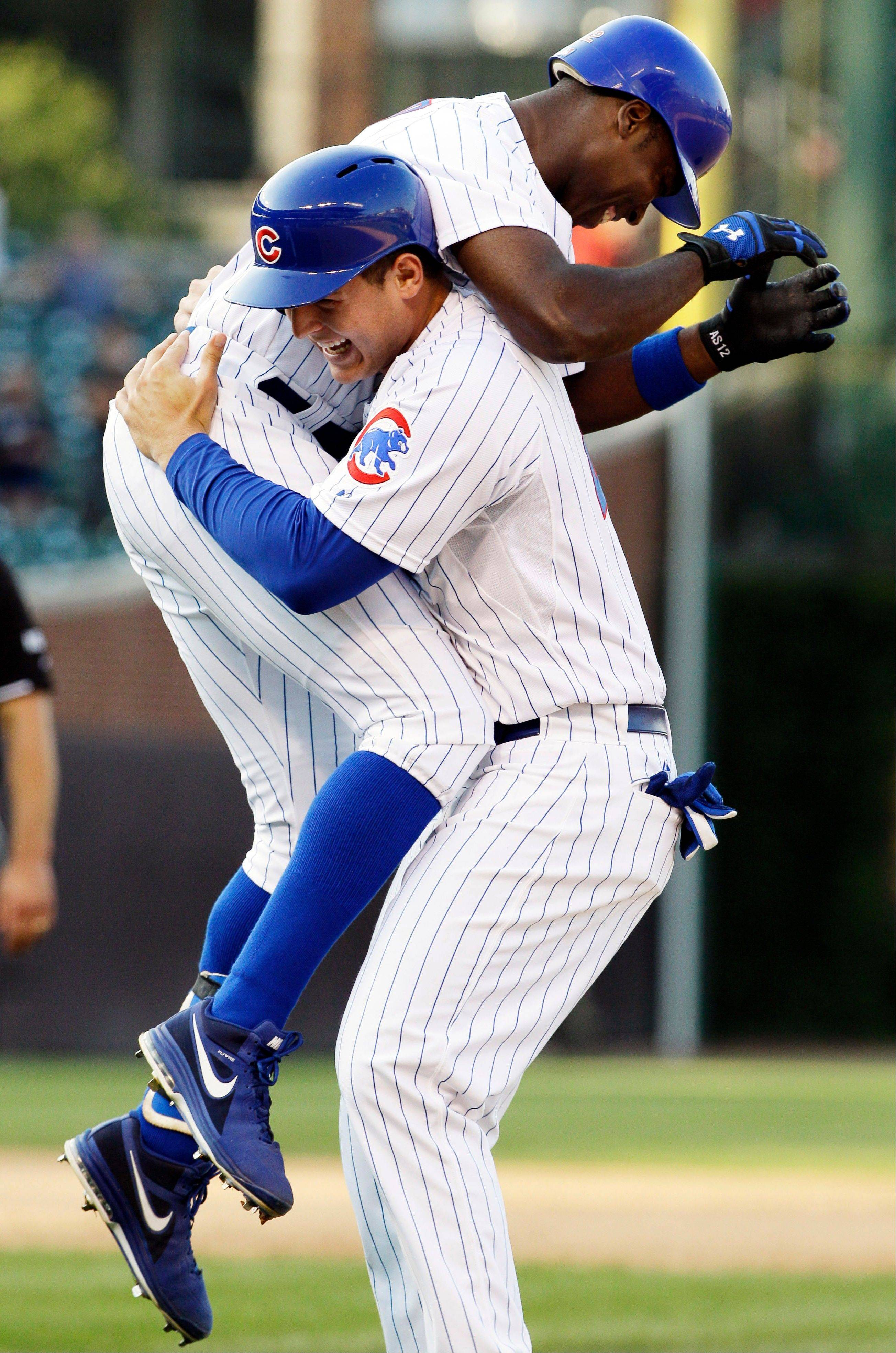 Chicago Cubs' Alfonso Soriano, top, celebrates with Anthony Rizzo after Soriano hit a game-winning RBI single to score Starlin Castro during the ninth inning of a baseball game against the Milwaukee Brewers in Chicago, Thursday, Aug. 30, 2012. The Cubs won 12-11.