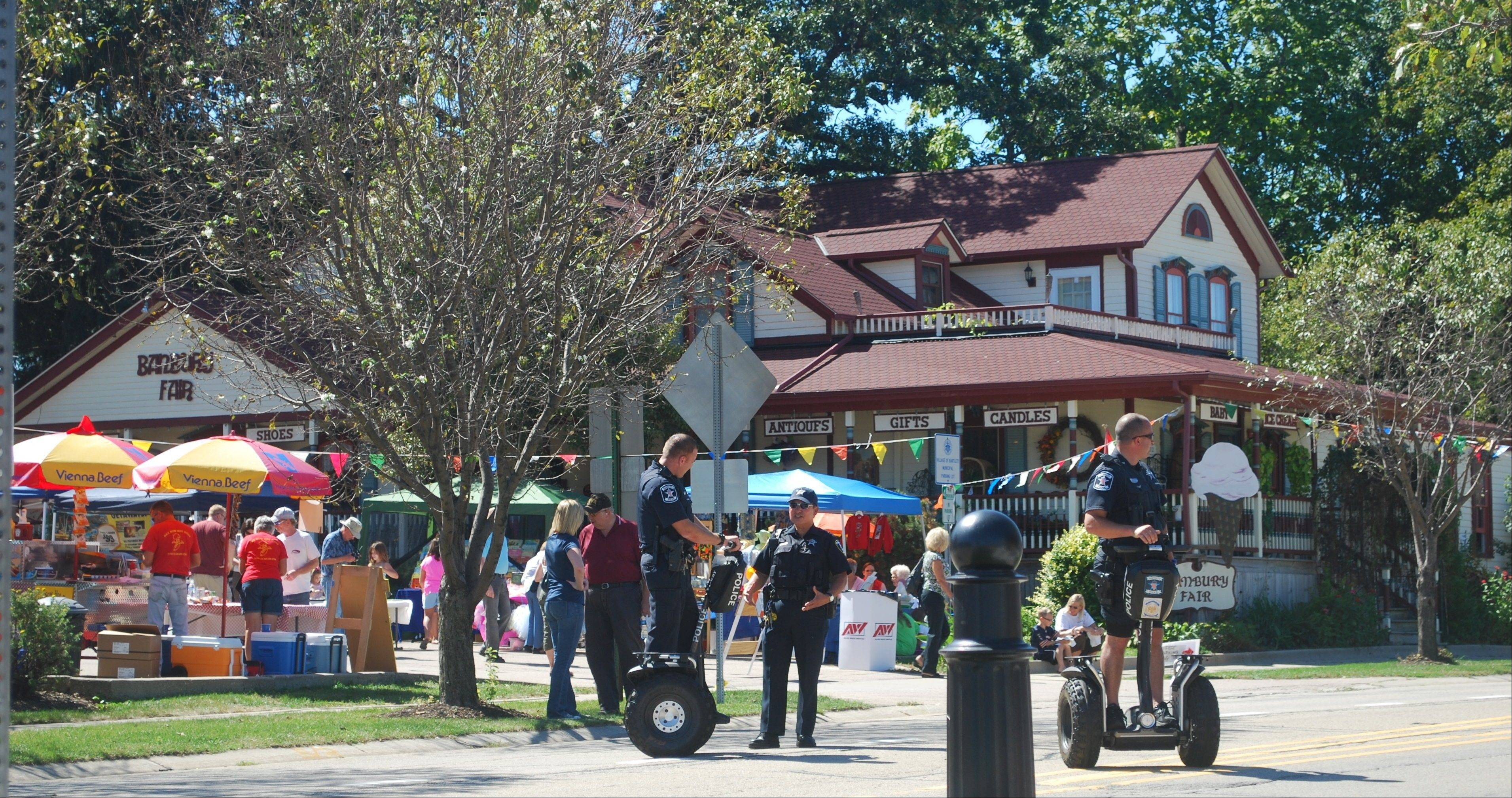 The old -- Banbury Fair, built in the 1880s -- blends with new, Bartlett police on Segways.