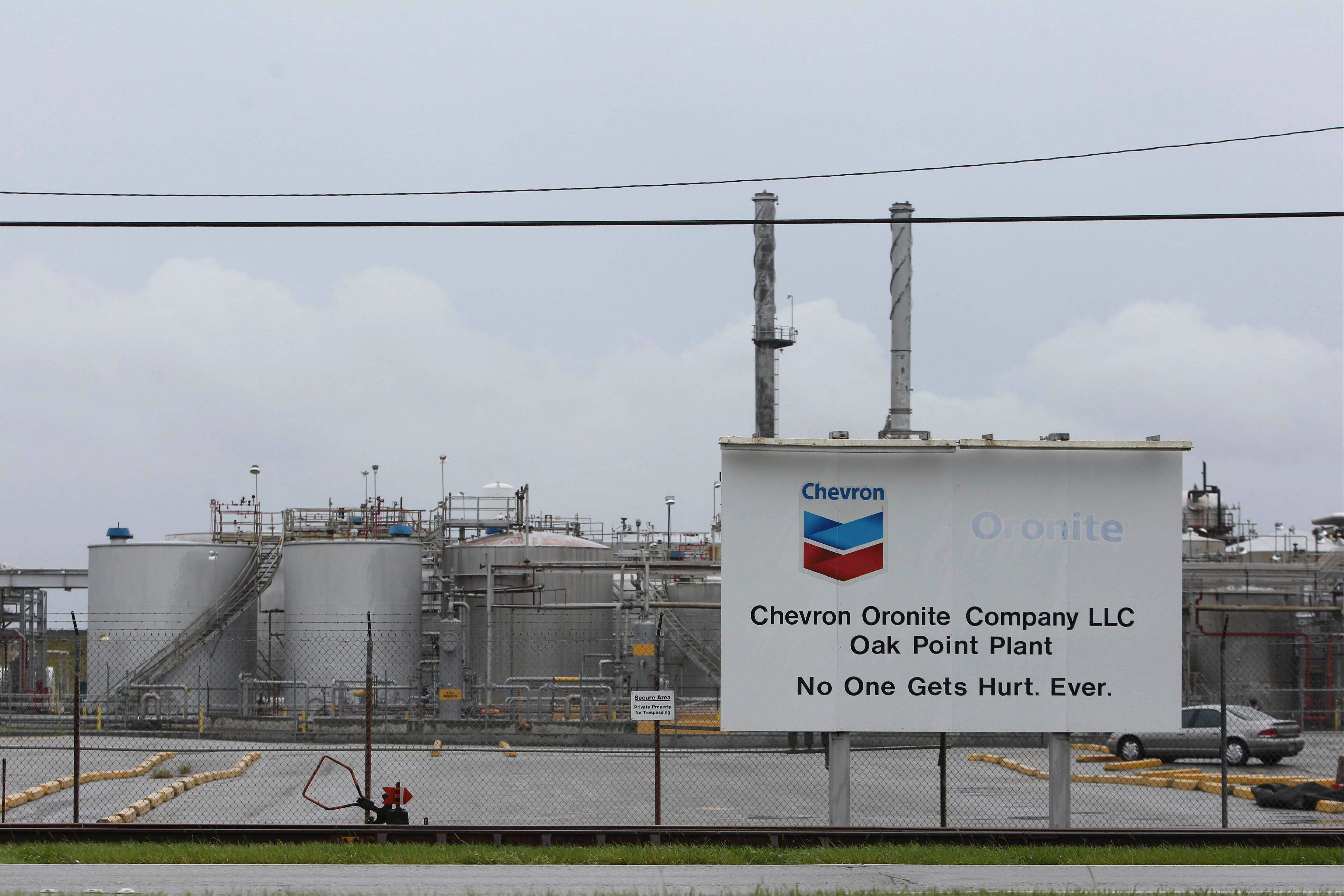 Signage is displayed Thursday outside the Chevron Corp. Oronite Oak Point Plant that was forced to close due to Hurricane Isaac in Belle Chasse, Louisiana.