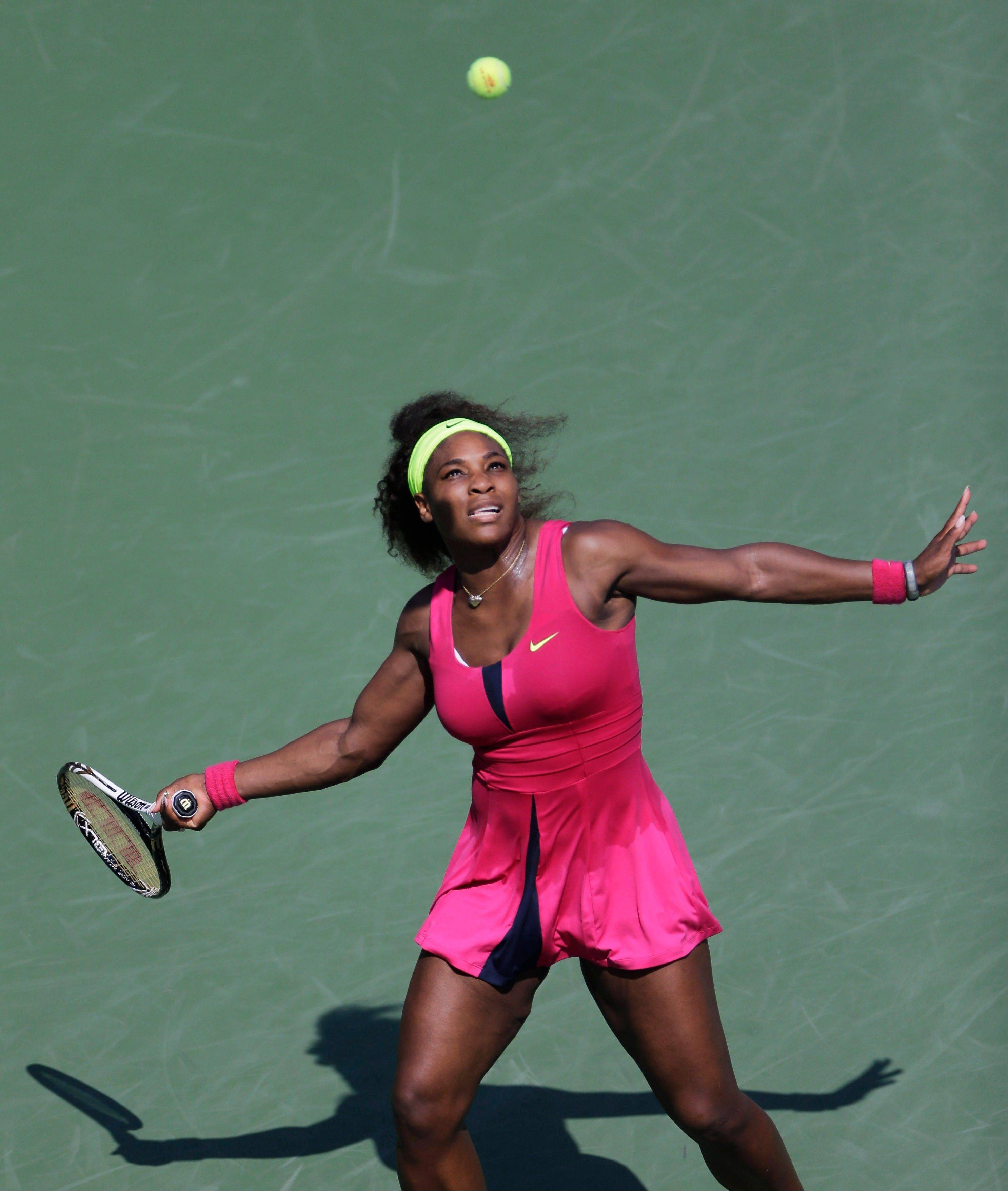 Serena Williams returns a shot to Russia's Ekaterina Makarova in the third round of play at the 2012 US Open tennis tournament, Saturday, Sept. 1, 2012, in New York. (AP Photo/Mike Groll)