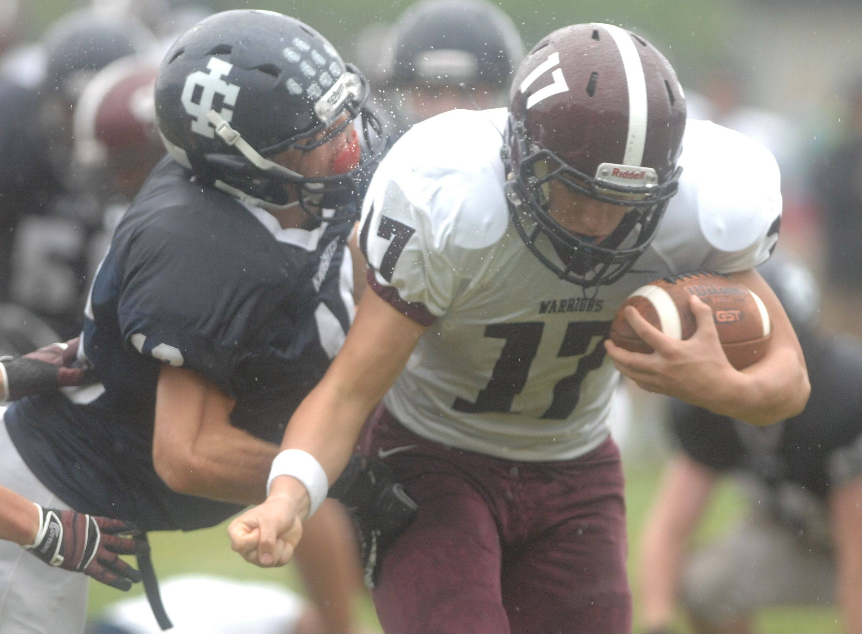 Nate Martinez of Wheaton Academy tries to get away from an Immaculate Conception defender during the Wheaton Academy vs. Immaculate Conception game in Elmhurst Saturday.