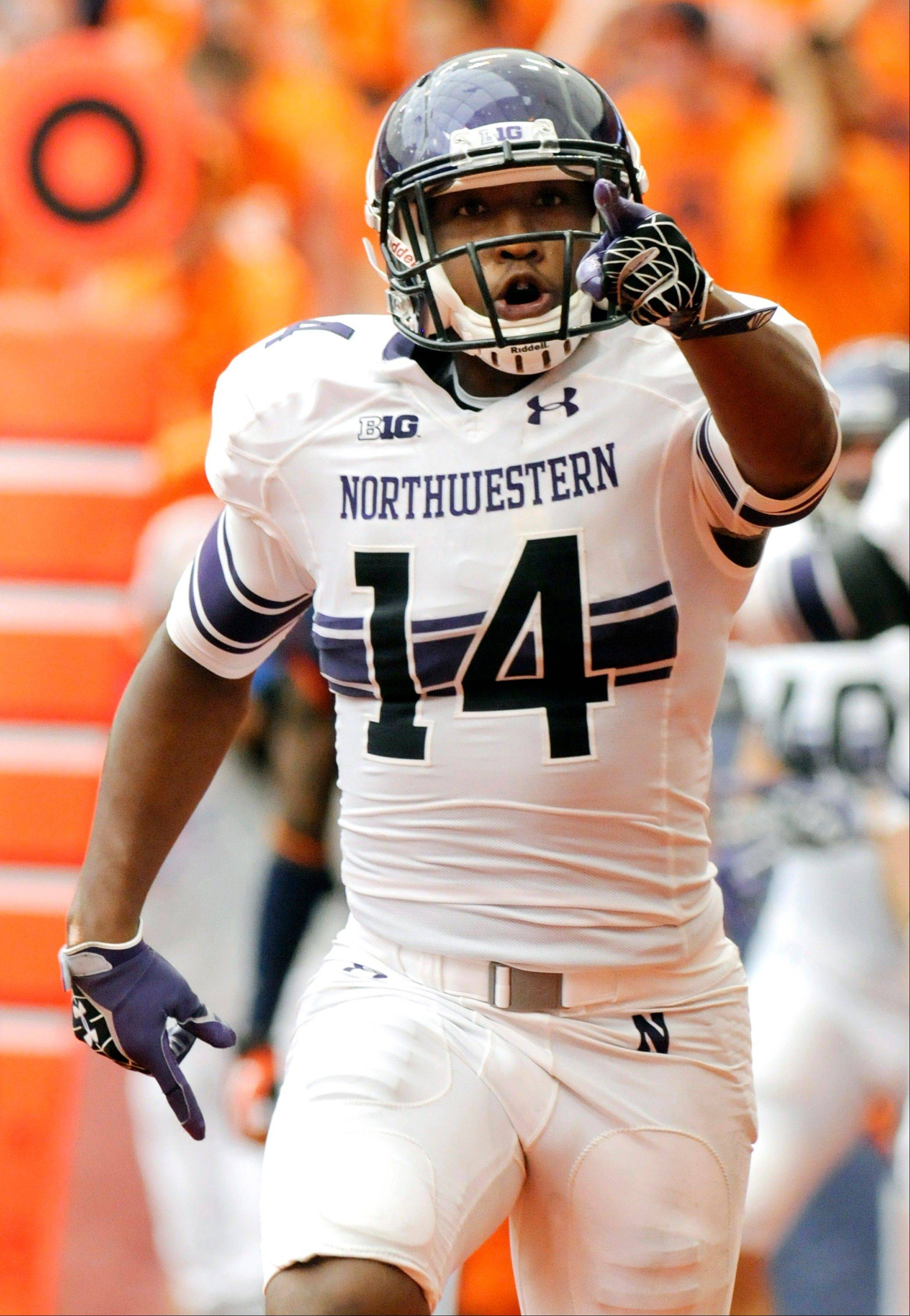 Northwestern's Christian Jones reacts after scoring against Syracuse during the second quarter of an NCAA college football game in Syracuse, N.Y., Saturday, Sept. 1, 2012. (AP Photo/Hans Pennink)