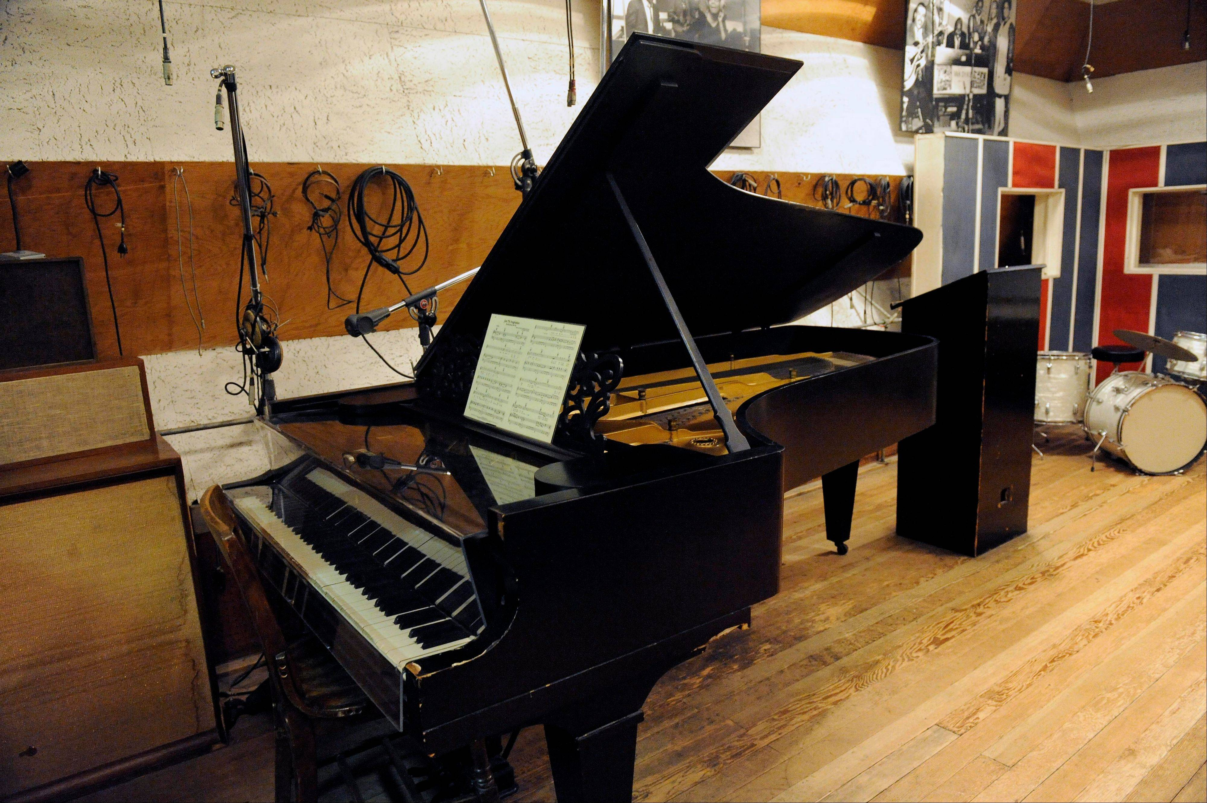 In this Oct. 31, 2011 photo, an 1877 Steinway grand piano used by Motown artists is seen in a Motown recording studio in Detroit. Now that an 1877 Steinway grand piano used by Motown artists has been restored, it's time for the historic instrument to be played. And who better to do that than ex-Beatle Paul McCartney, who orchestrated the piano's refurbishment, and Berry Gordy, the architect of the Motown music label.