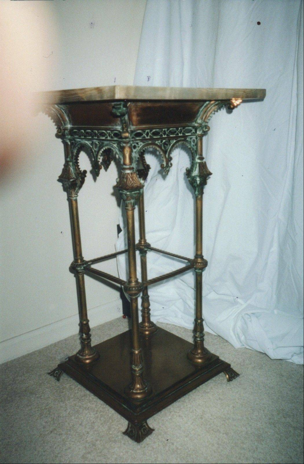 This brass plant stand is late Victorian in the Gothic Revival style.