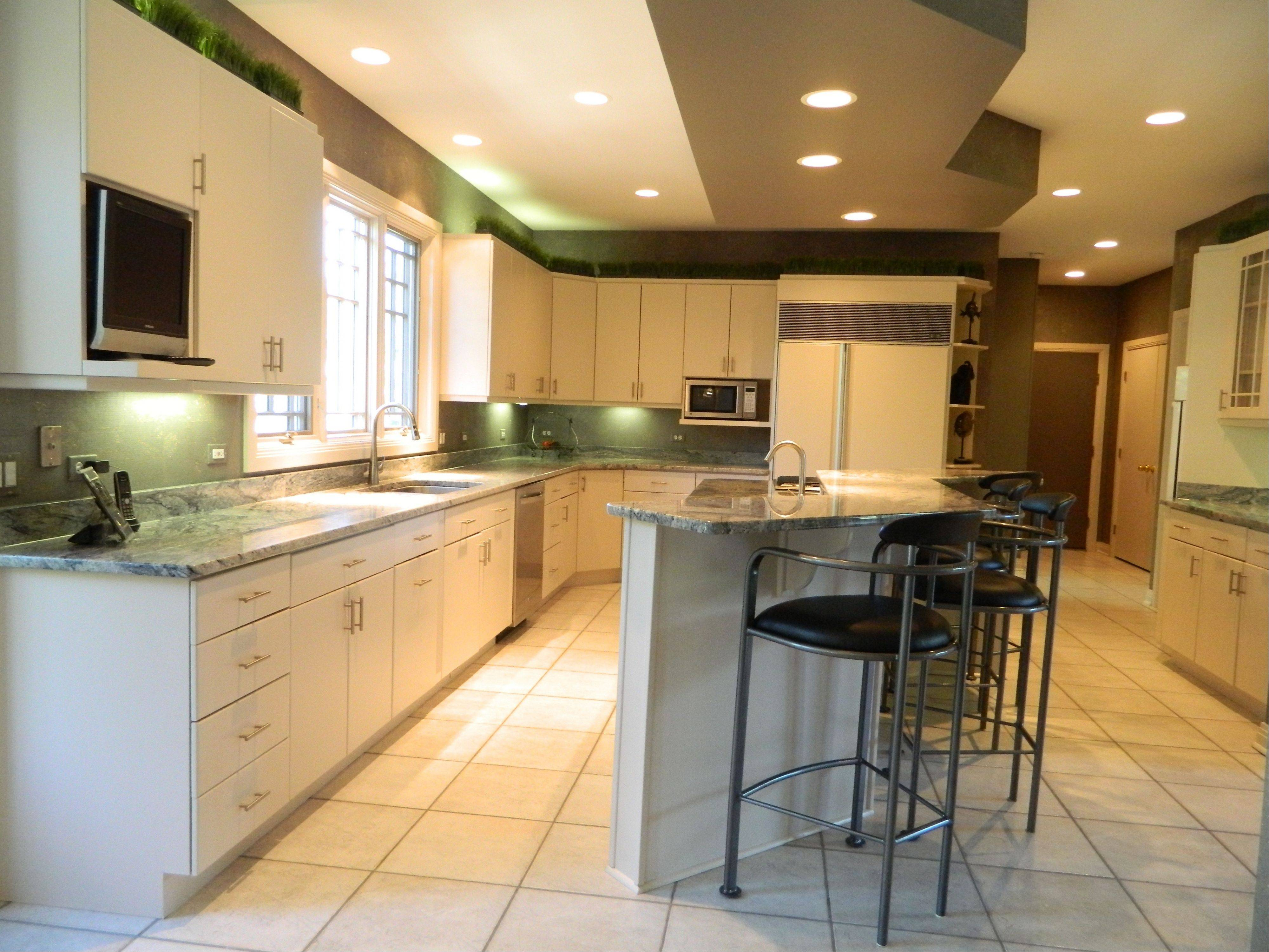 The home has a contemporary, ceramic-tiled kitchen.