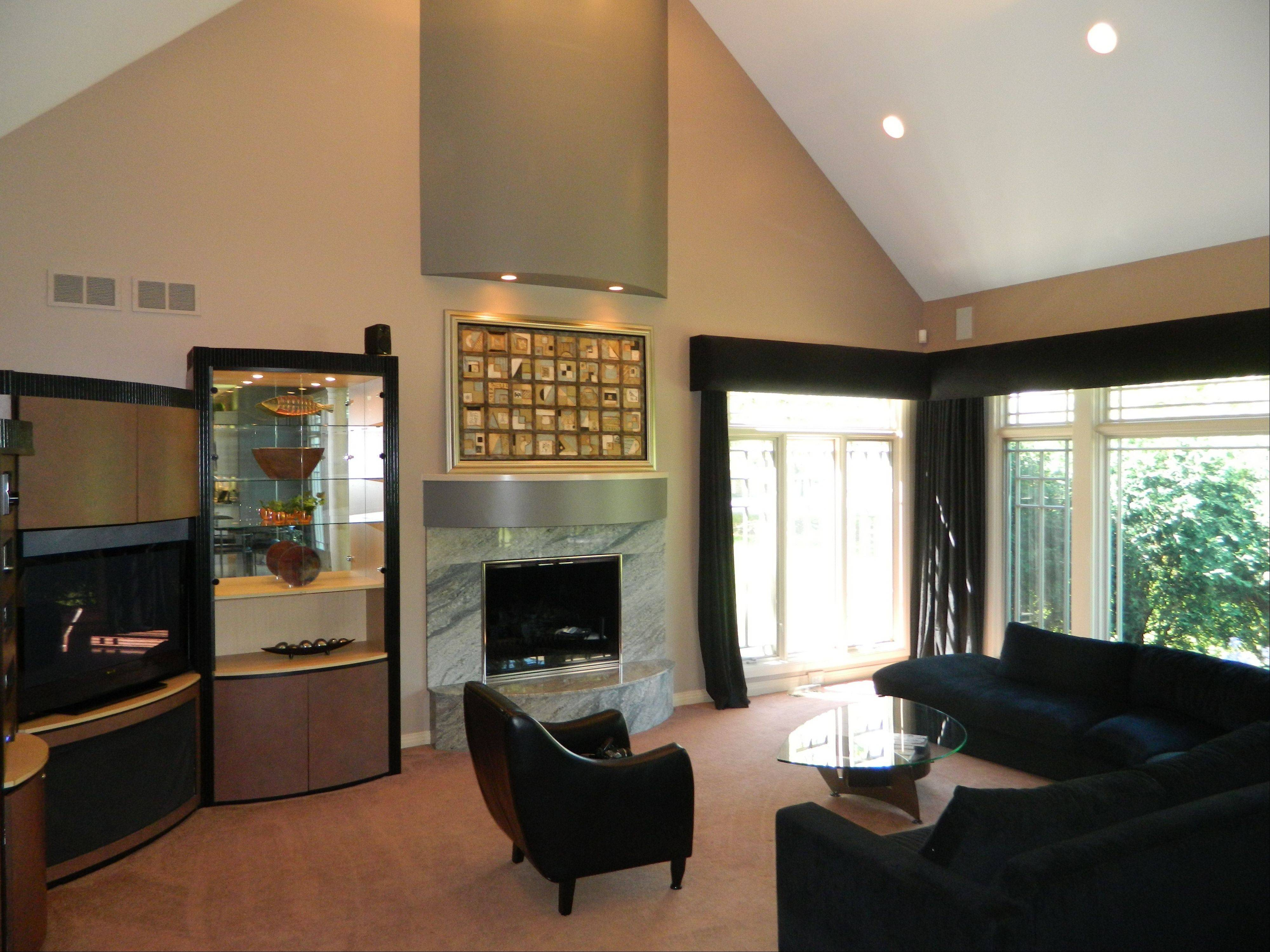 Vaulted ceilings add to the large dimensions of the living room.