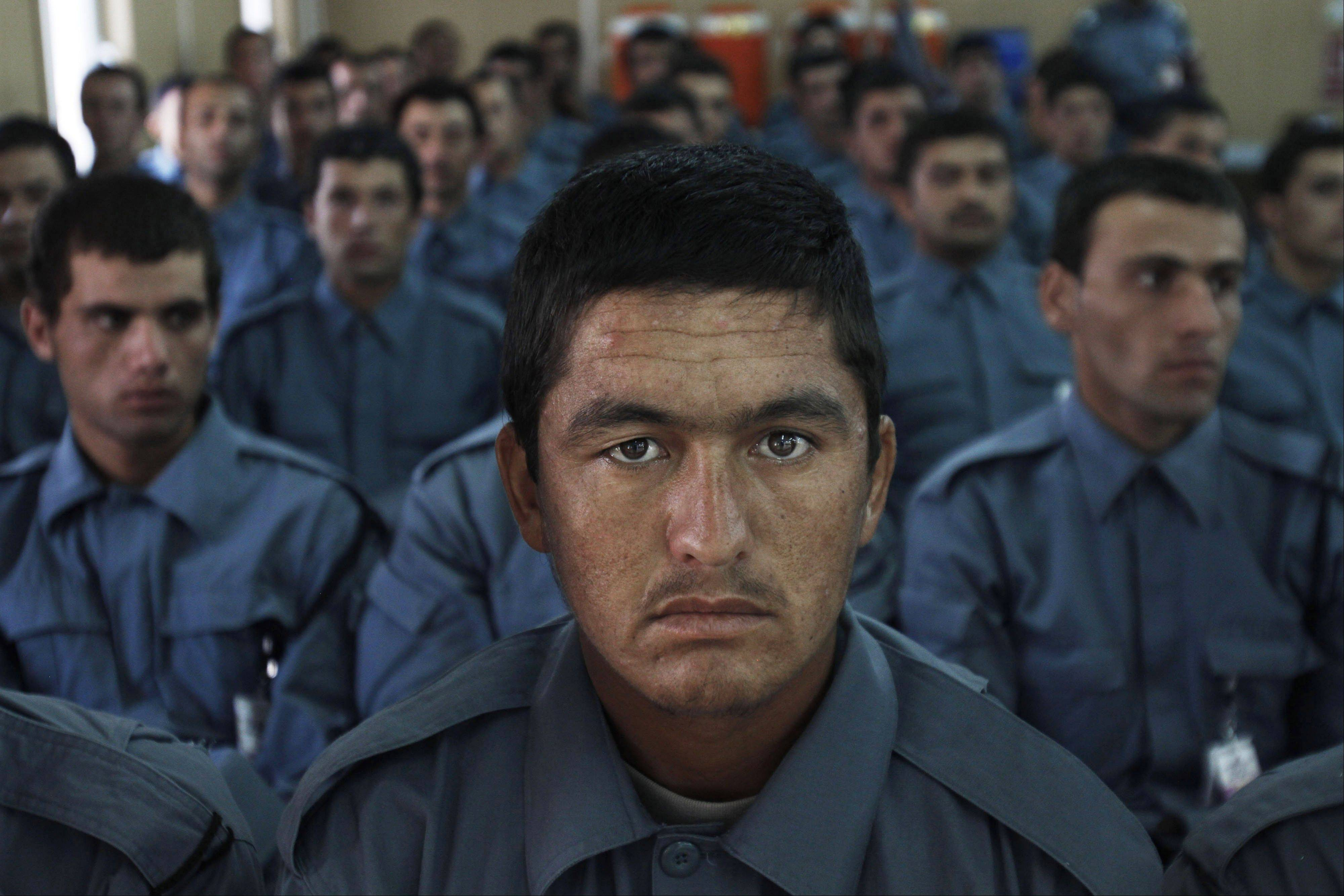 Afghan national police officers attend their graduation ceremony Thursday at a National Police training center in Jalalabad, east of Kabul, Afghanistan.