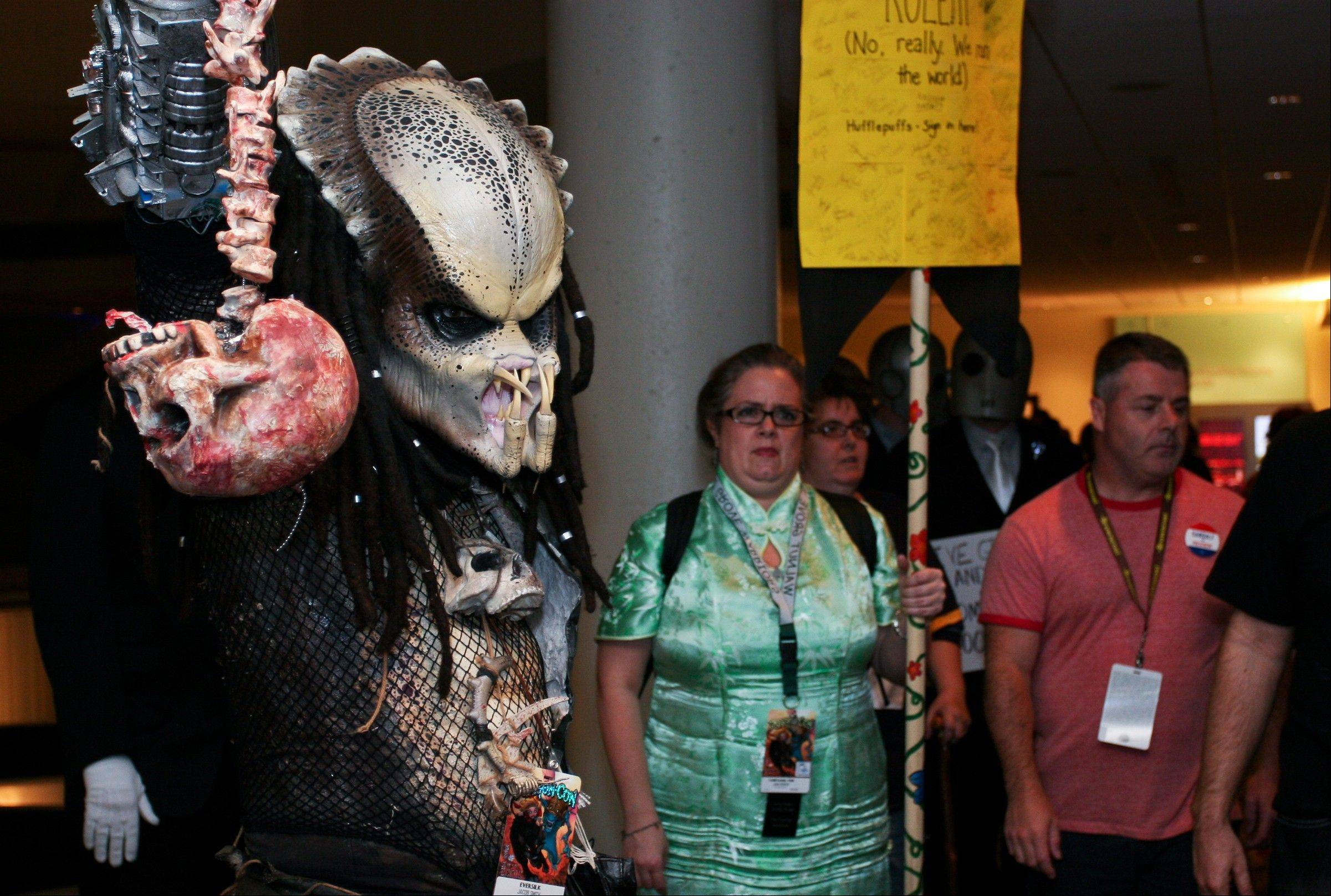 "A Dragon Con attendee is dressed as a character from the movie ""Predator"" at Dragon Con in Atlanta, on Friday."