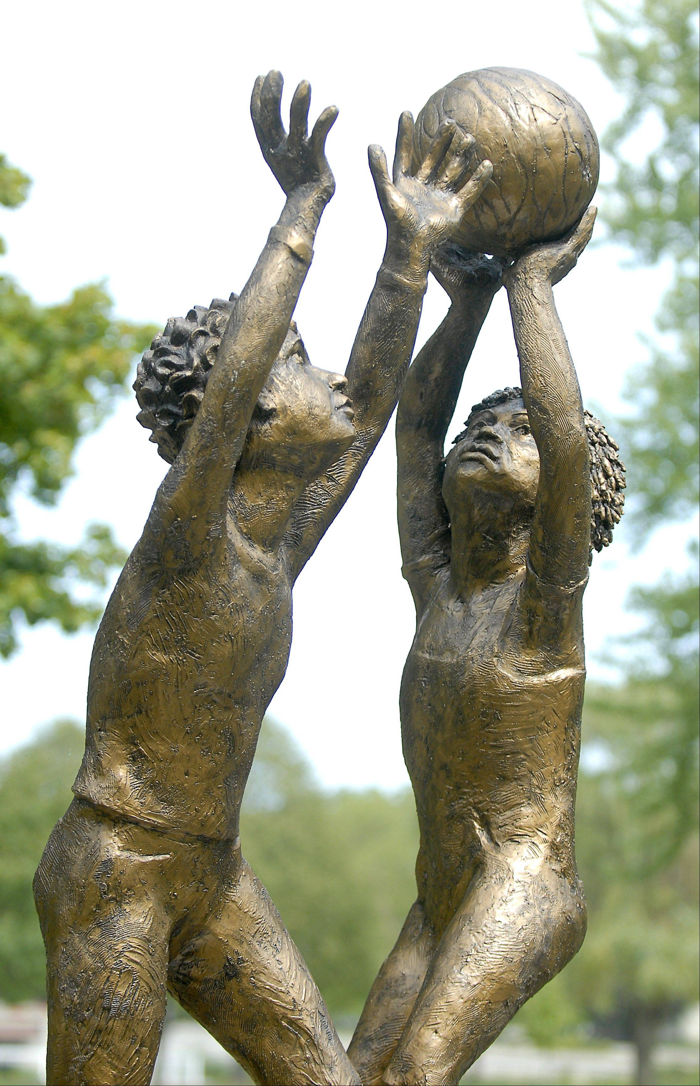 "The ""Enlighten"" sculpture by Margo McMahon of Oak Park is on display at Mount St. Mary Park in St. Charles."
