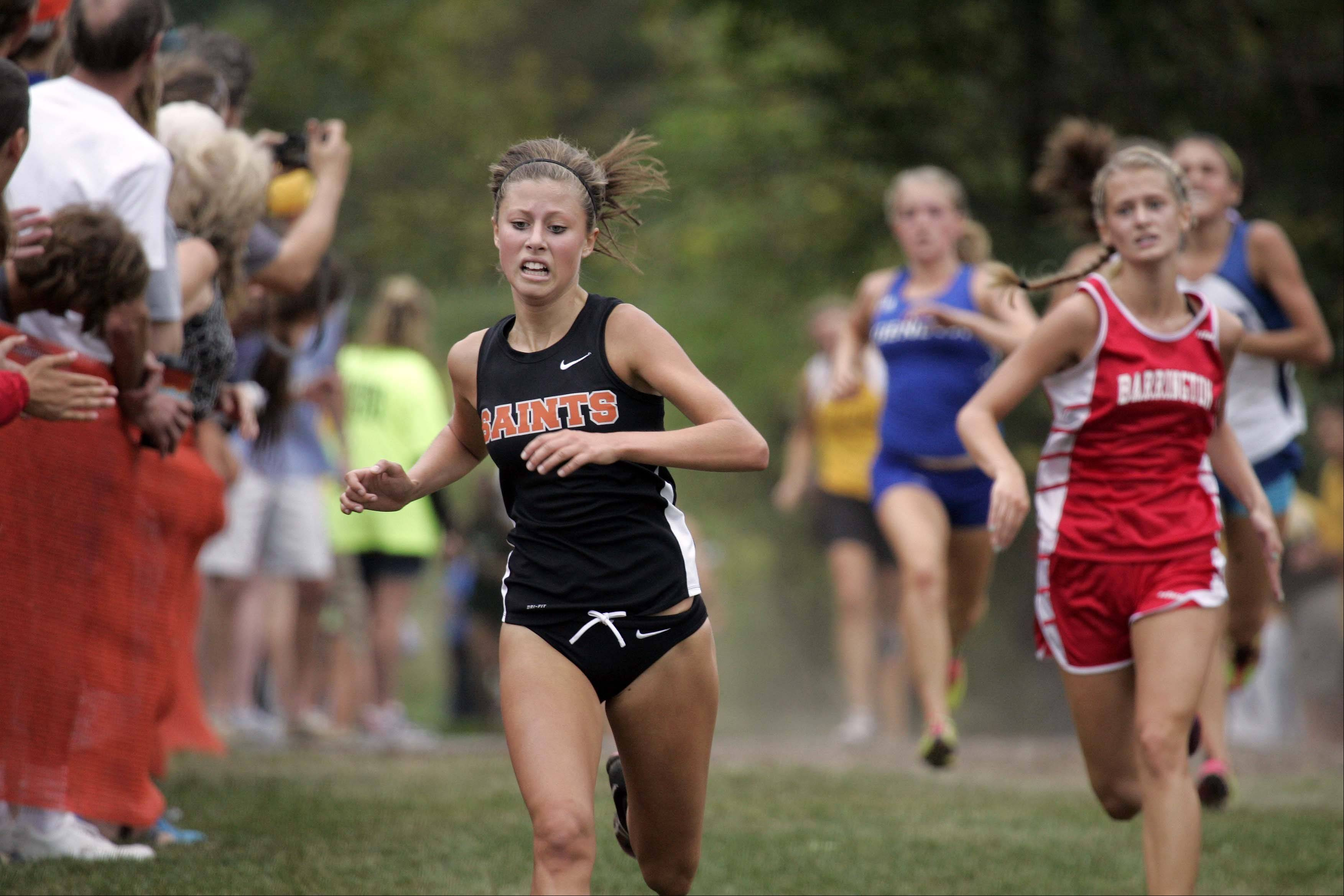 St. Charles East's Torree Scull races to ninth place during the girls varsity race at the St. Charles East cross country meet at LeRoy Oakes in St. Charles Saturday September 1, 2012.