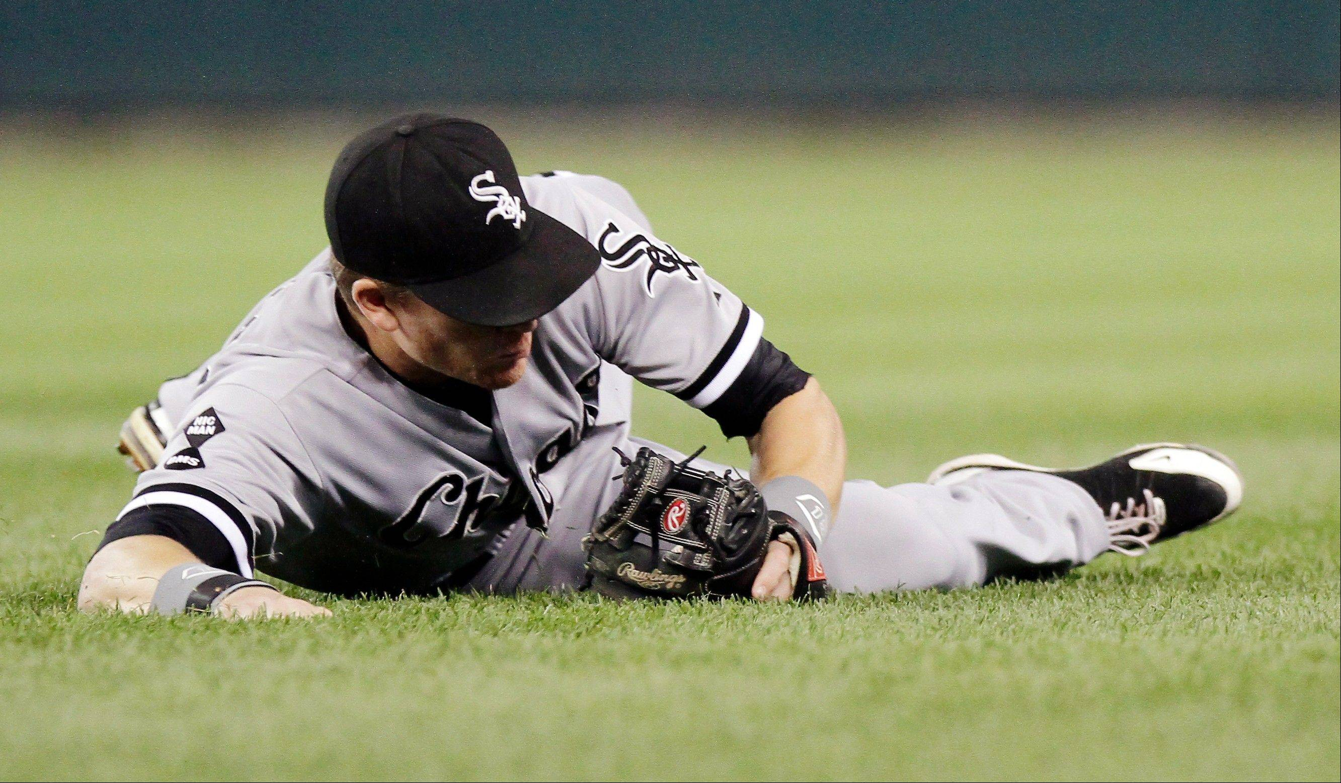 White Sox second baseman Gordon Beckham smothers a ground ball hit by Detroit Tigers' Prince Fielder to throw him out at first base in the sixth inning of a baseball game Saturday in Detroit.