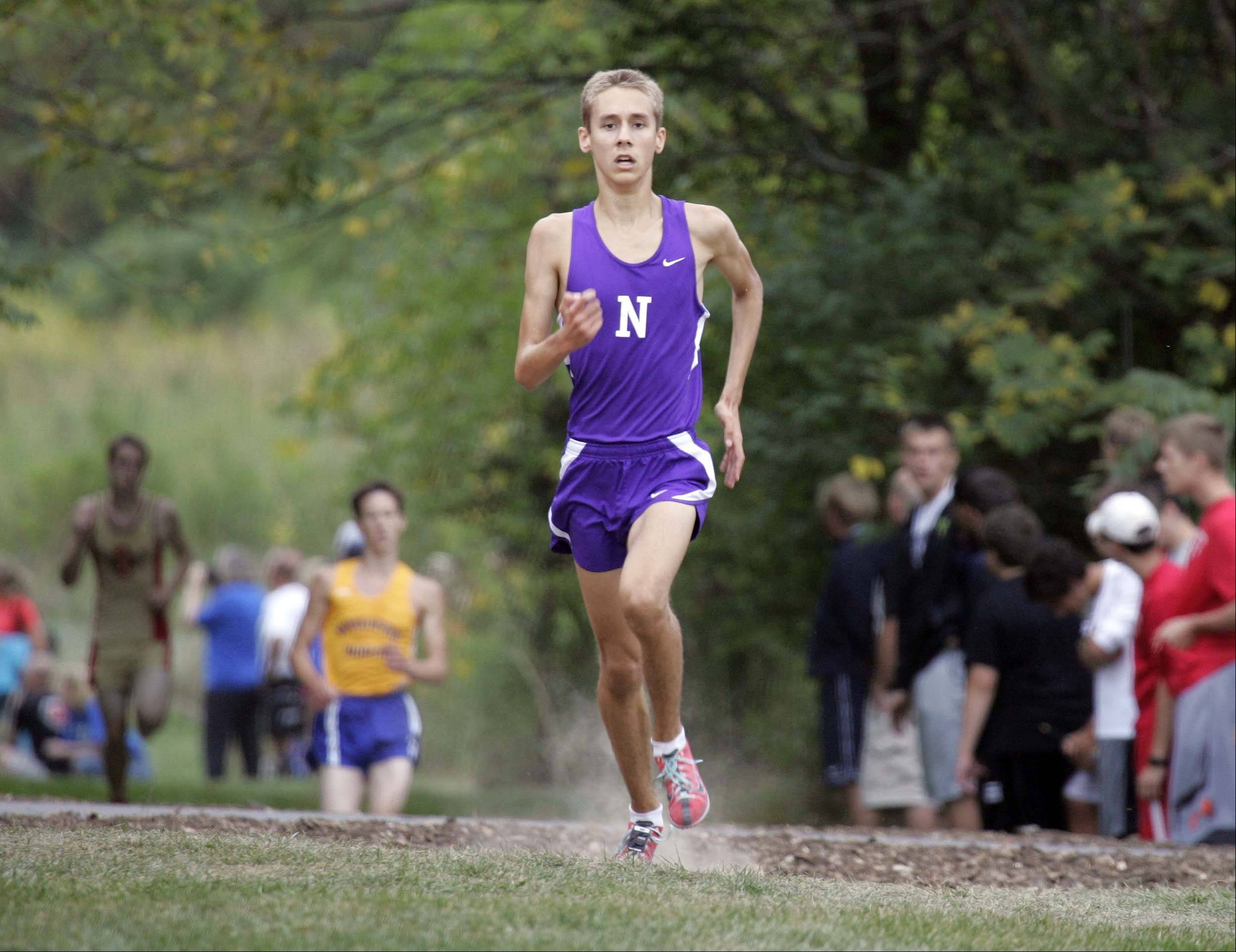 Downers Grove North Ben Eaton races to third place during the boys varsity race at the St. Charles East cross country meet at LeRoy Oakes in St. Charles Saturday September 1, 2012.