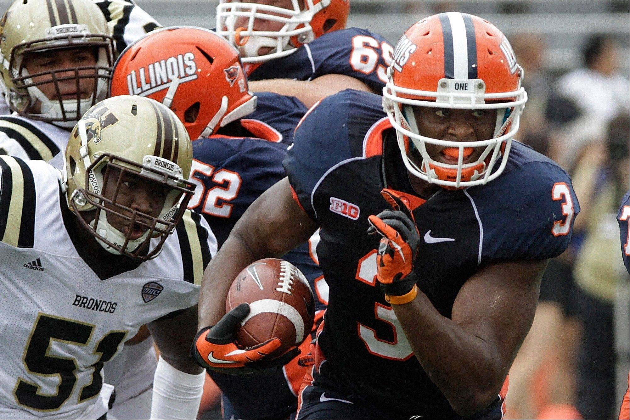 Illinois tight end Jon Davis (3) runs with the ball away from Western Michigan linebacker Desmond Bozeman (51) during the first half of an NCAA college football game Saturday in Champaign, Ill. Illinois defeated Western Michigan 24-7.