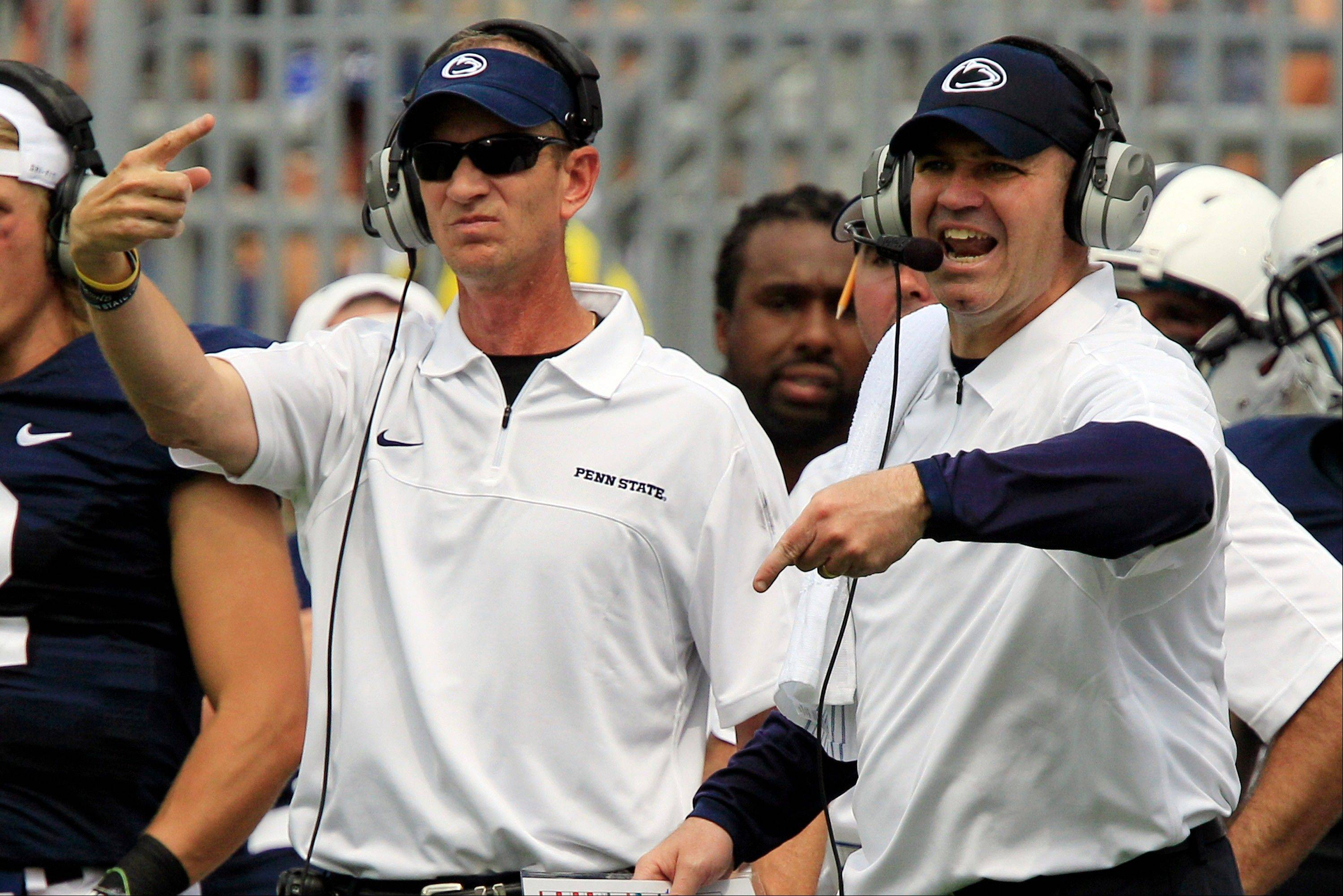 Penn State head coach Bill O'Brien, right, and quarterbacks coach Charlie Fisher, instruct from the sidelines during the first quarter of an NCAA college football game against Ohio at Beaver Stadium in State College, Pa., Saturday, Sept. 1, 2012. Penn State fans ushered in a new era in the football program with a raucous ovation as the team stormed the field for their first game under coach Bill O'Brien.
