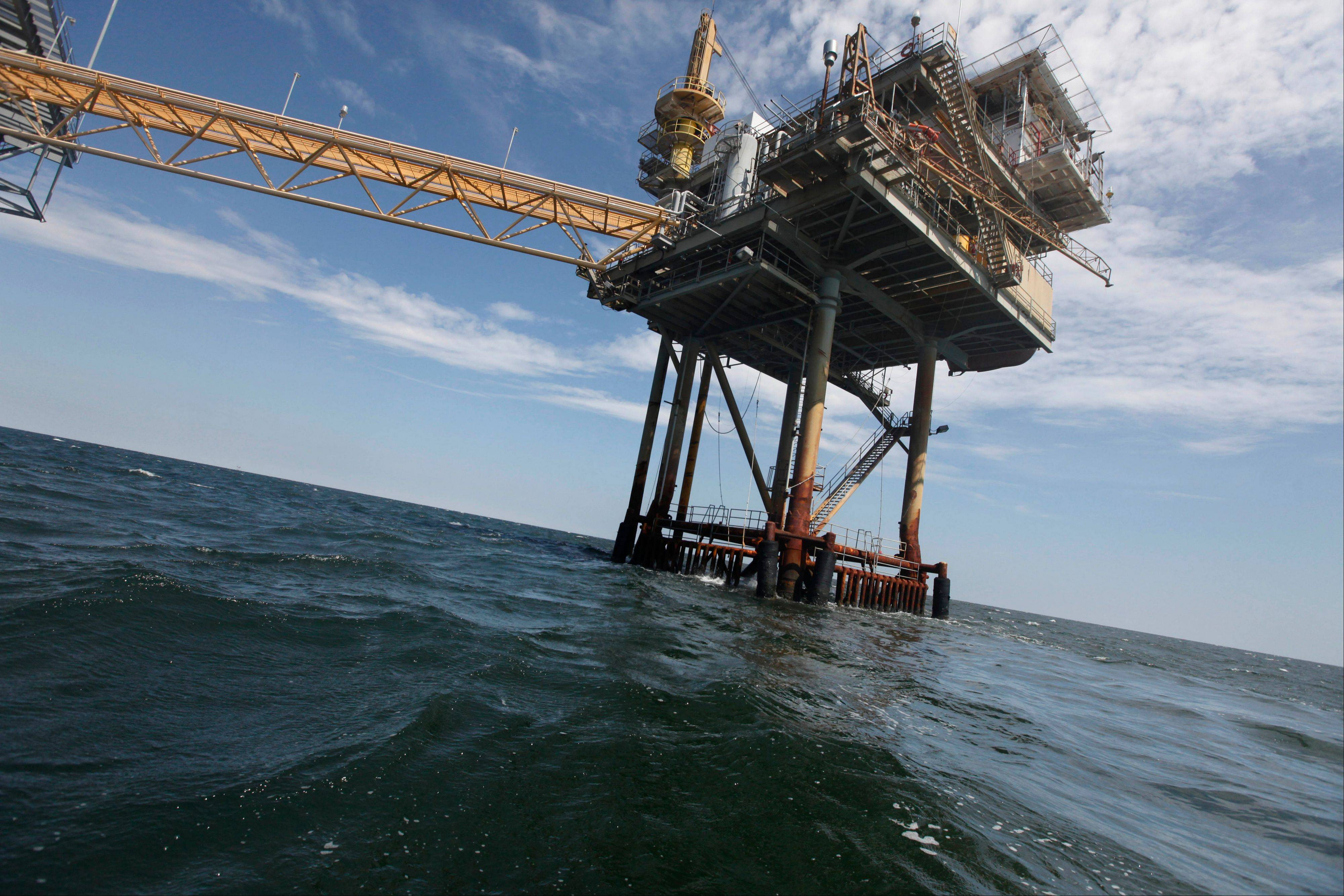 An oil rig is seen in the Gulf of Mexico near the Chandeleur Islands, off the Southeastern tip of Louisiana. Energy companies have reoccupied many of the production platforms in the Gulf of Mexico that were abandoned in advance of Hurricane Isaac.
