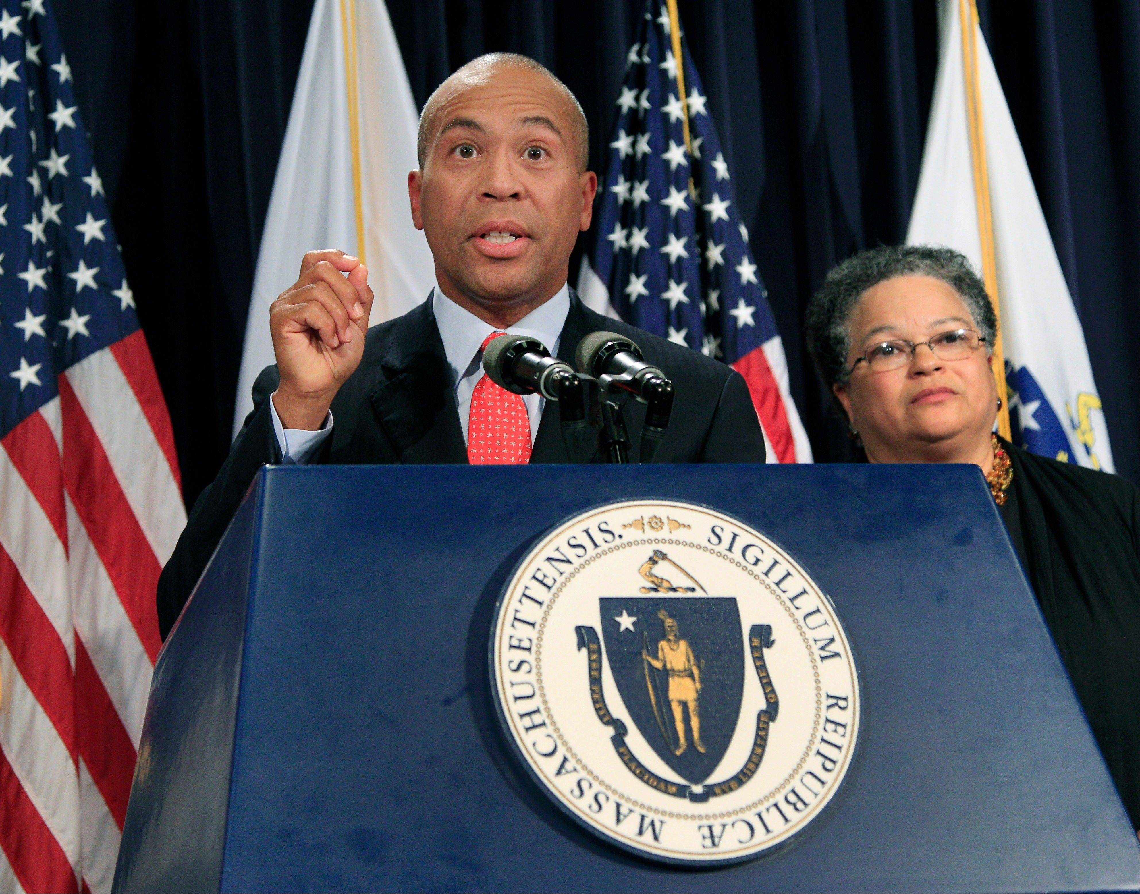 ASSOCIATED PRESS Massachusetts Gov. Deval Patrick speaks, as Health and Human Services Secretary JudyAnn Bigby listens at right, during a news conference at the Statehouse in Boston, where he spoke about the U.S. Supreme Court's decision to uphold President Barack Obama's health care overhaul.