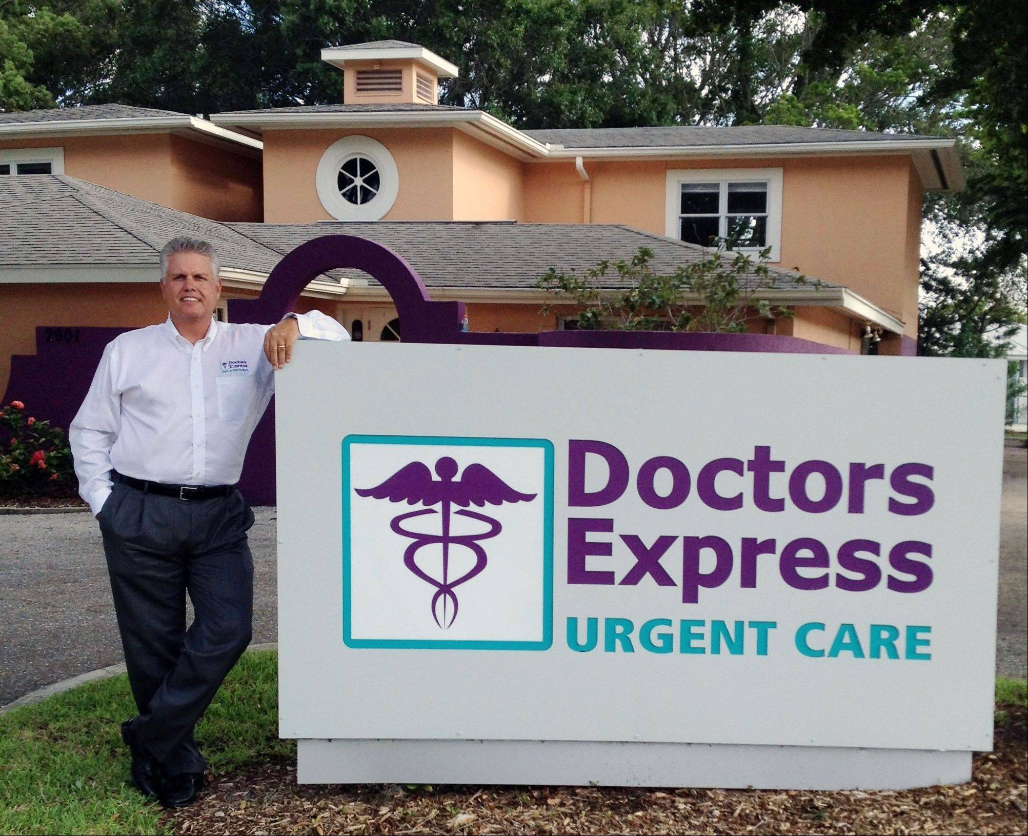 Rick Kimsey stands in front of his franchise, Doctors Express urgent care Facility in Sarasota, Fla. The business came with a concept and a service to sell. All he had to do was get the franchise up and running, and then operate it. However, many first-time buyers like Kimsey are finding it's harder than they expected to buy and run a franchise.