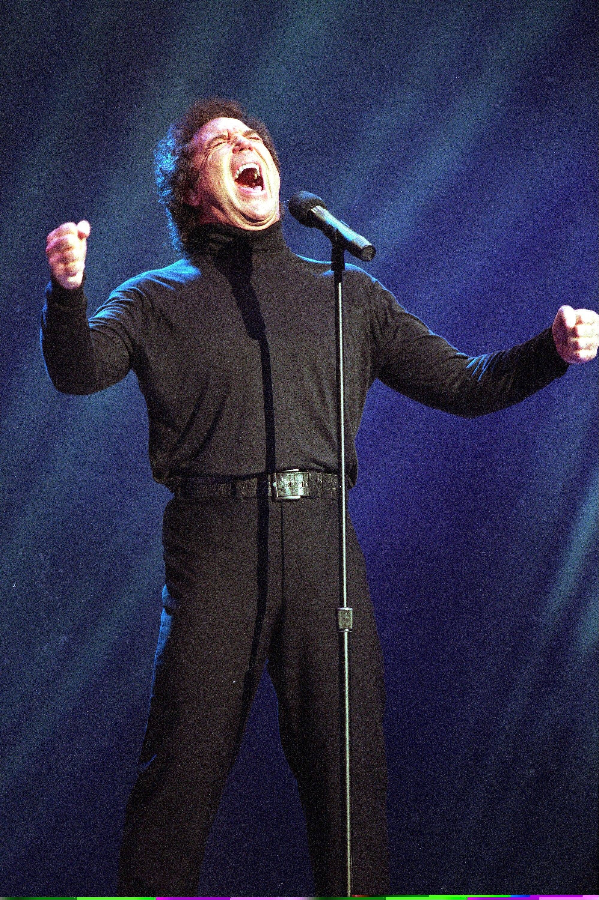 "In this Jan. 30, 1995 file photo, Tom Jones, co-host of the American Music Awards, sings ""I Wanna Get Back With You"" during his performance segment of the telecast at the Shrine Auditorium in Los Angeles. Hal David, the stylish, heartfelt lyricist who teamed with Burt Bacharach on dozens of timeless songs for movies, television and a variety of recording artists in the 1960s and beyond, died Saturday, Sept. 1, 2012. He was 91. David and Bacharach wrote the lyrics for ""What's New Pussycat,"" made famous by Jones."