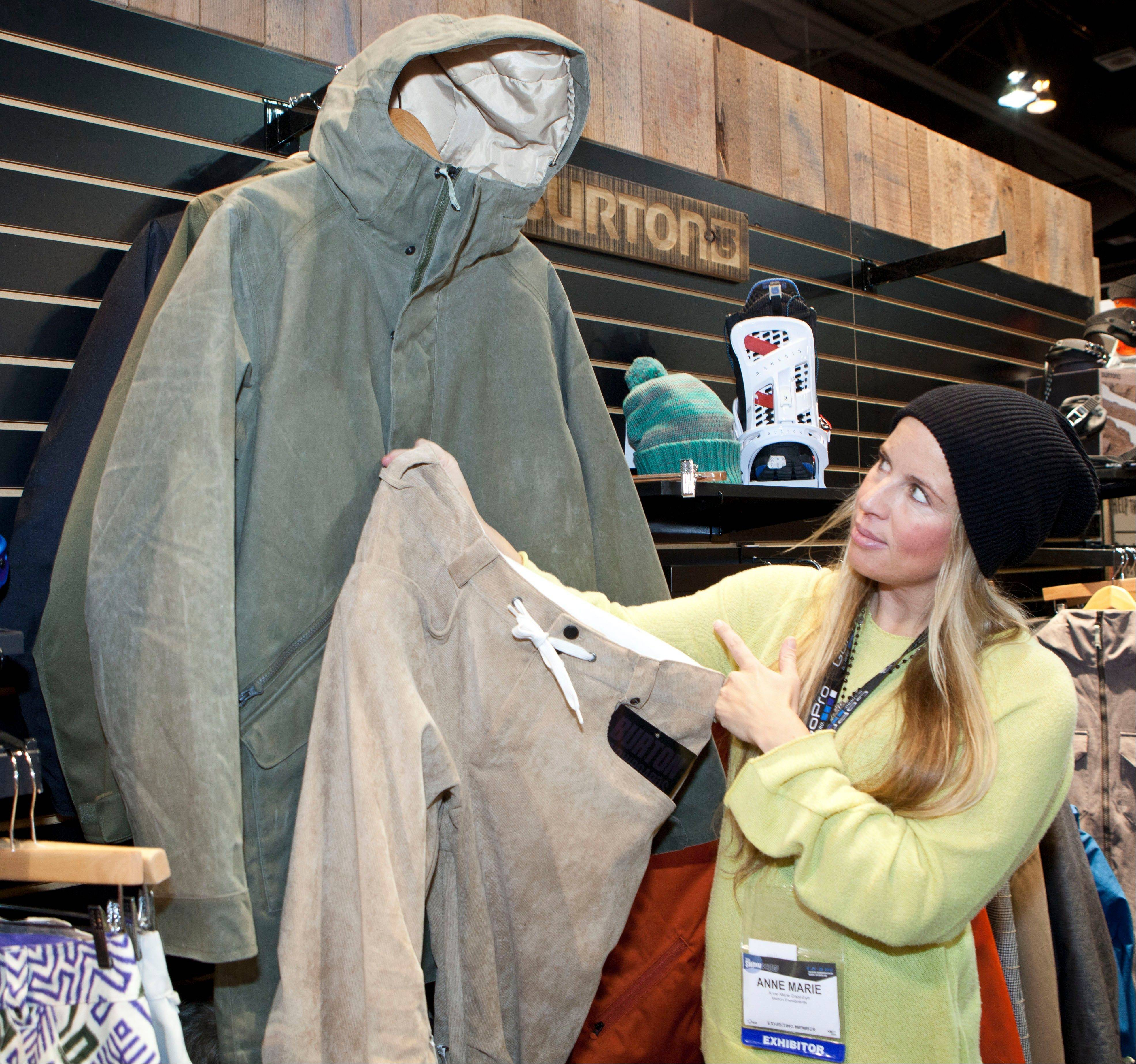Anne Maria Dacyshyn, Global PR Director for Burton, shows Burton's newest tech apparel collection at the annual SAI Snow Show in Denver. It includes pieces that would look at home on a city street but also work for the slopes. The men's collection has a waterproof soft-shell hoodie with fleece lining and pants designed with insulation and water-repellant materials, and a technical, high-performance corduroy.