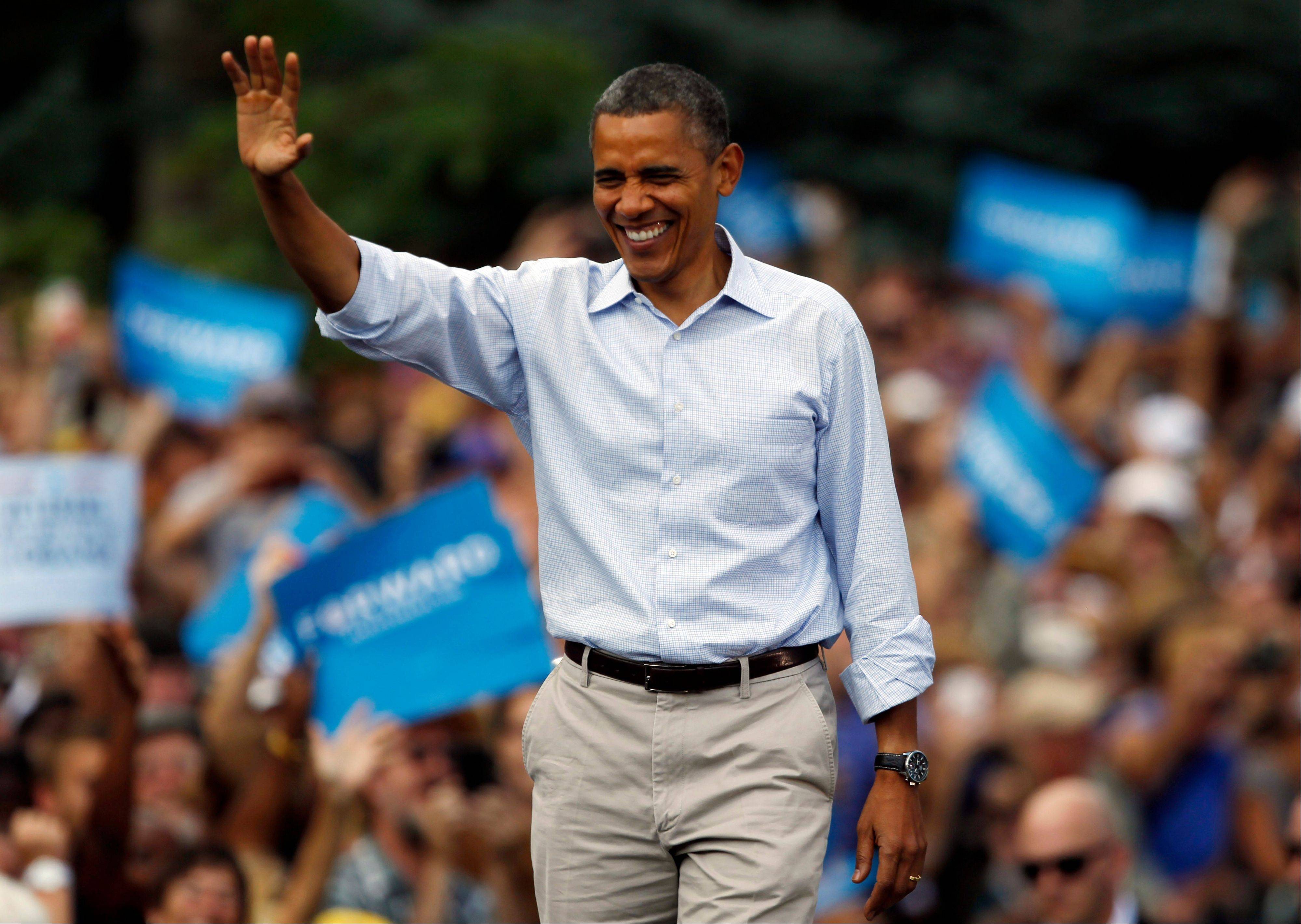 President Barack Obama waves as he walks on stage during campaign stop on the campus of the University of Colorado in Boulder, Colo., Sunday. Why couldn't he deliver the change he promised four years ago? The answer depends on what political party one listens to.