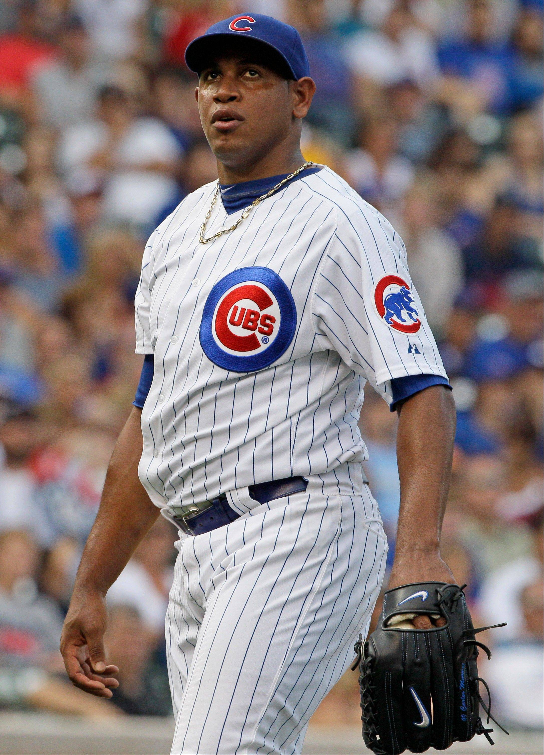Cubs relief pitcher Carlos Marmol gave up the winning runs Sunday against the San Francisco Giants.