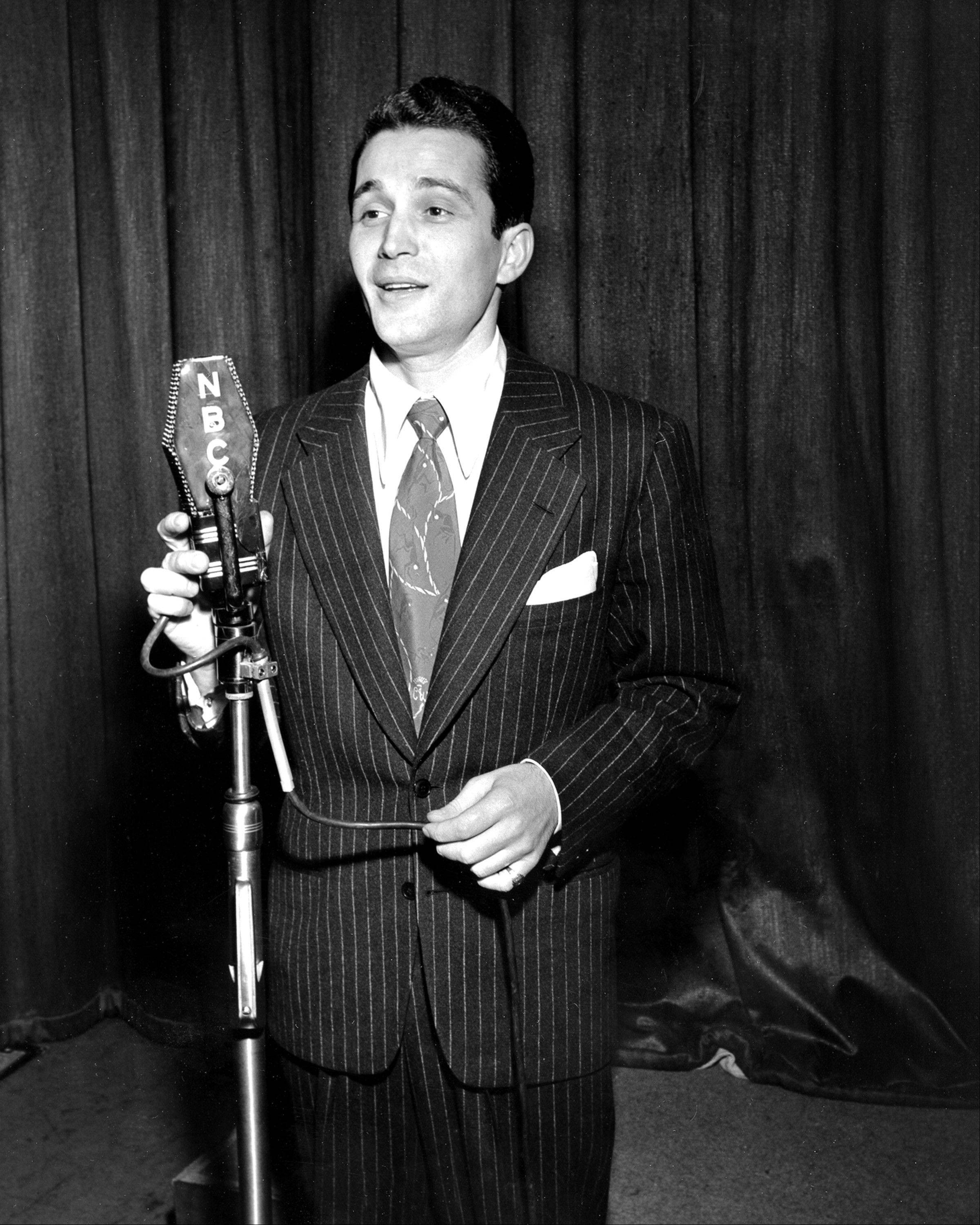 "In this Feb. 20, 1945 file photo, Perry Como sings during his radio broadcast of ""The Chesterfield Supper Club"" in New York City."