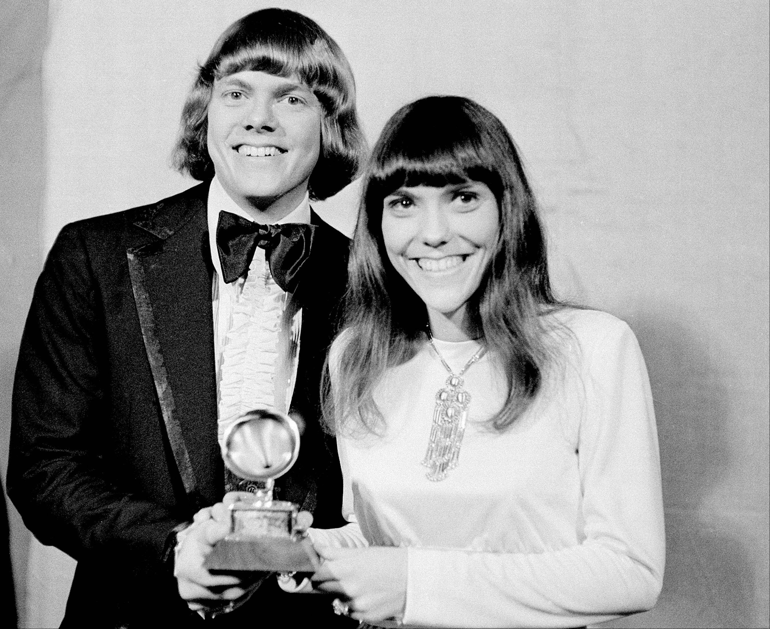 "In this March 17, 1971 file photo, The Carpenters: Richard and Karen, pose with their Grammy during the 13th annual 1970 Grammy Awards in Los Angeles. The brother-sister duo a Grammy for ""Close to You,"" which was written by Hal David."