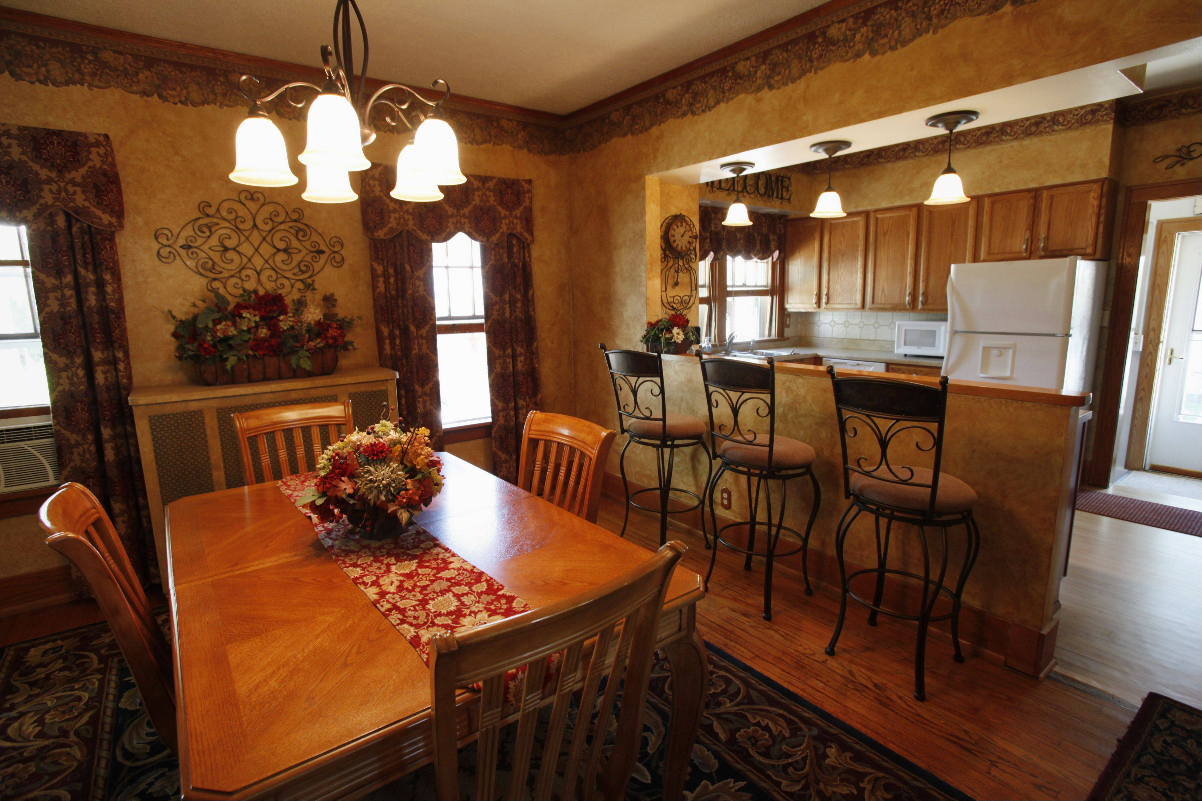 Homeowner Jean LeRoy took out part of the wall between her kitchen and dining room to create a more open floor plan at 670 Oak St. in Elgin.