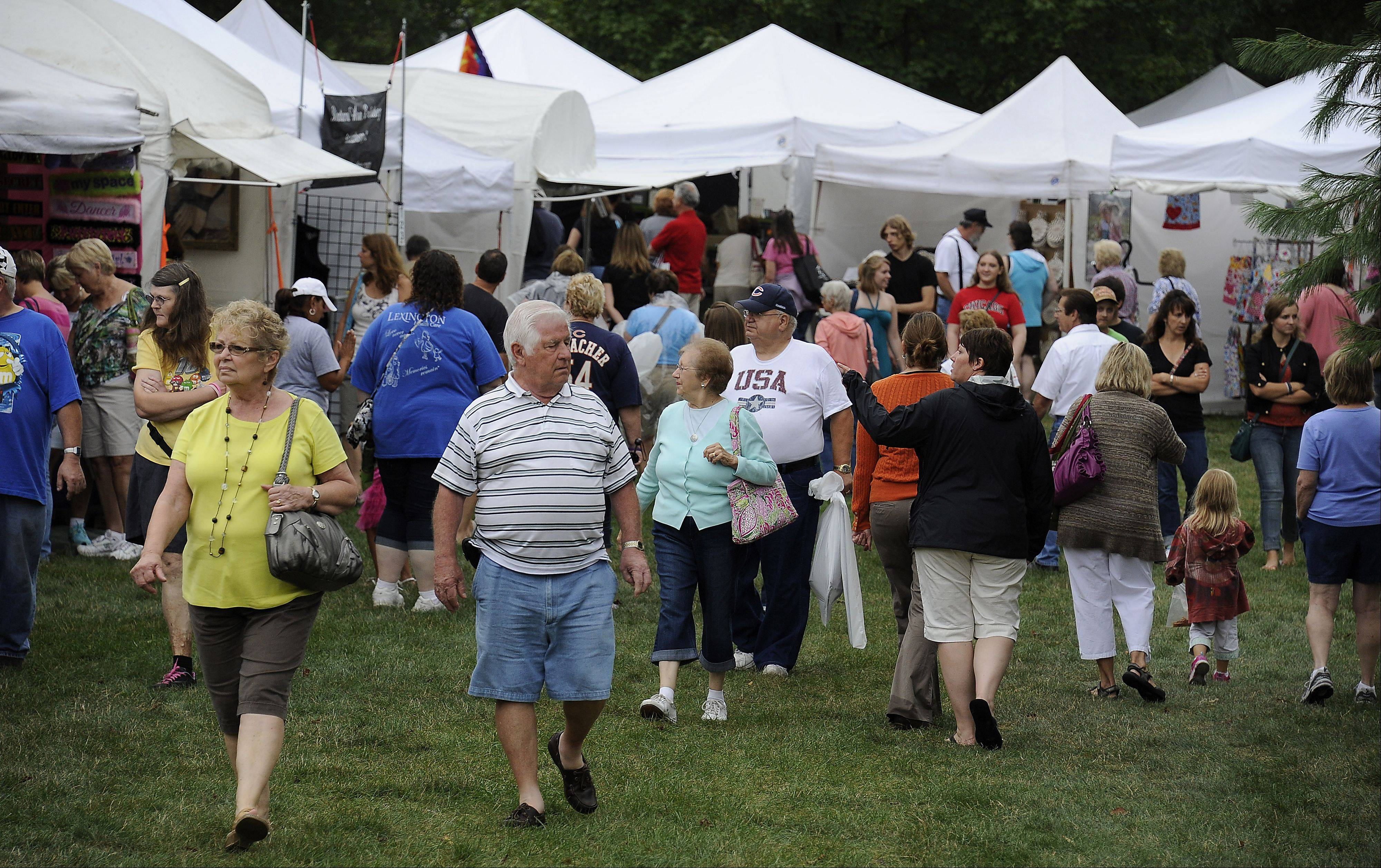 Despite the rain, large crowds decend on Septemberfest in Schaumburg on Saturday.