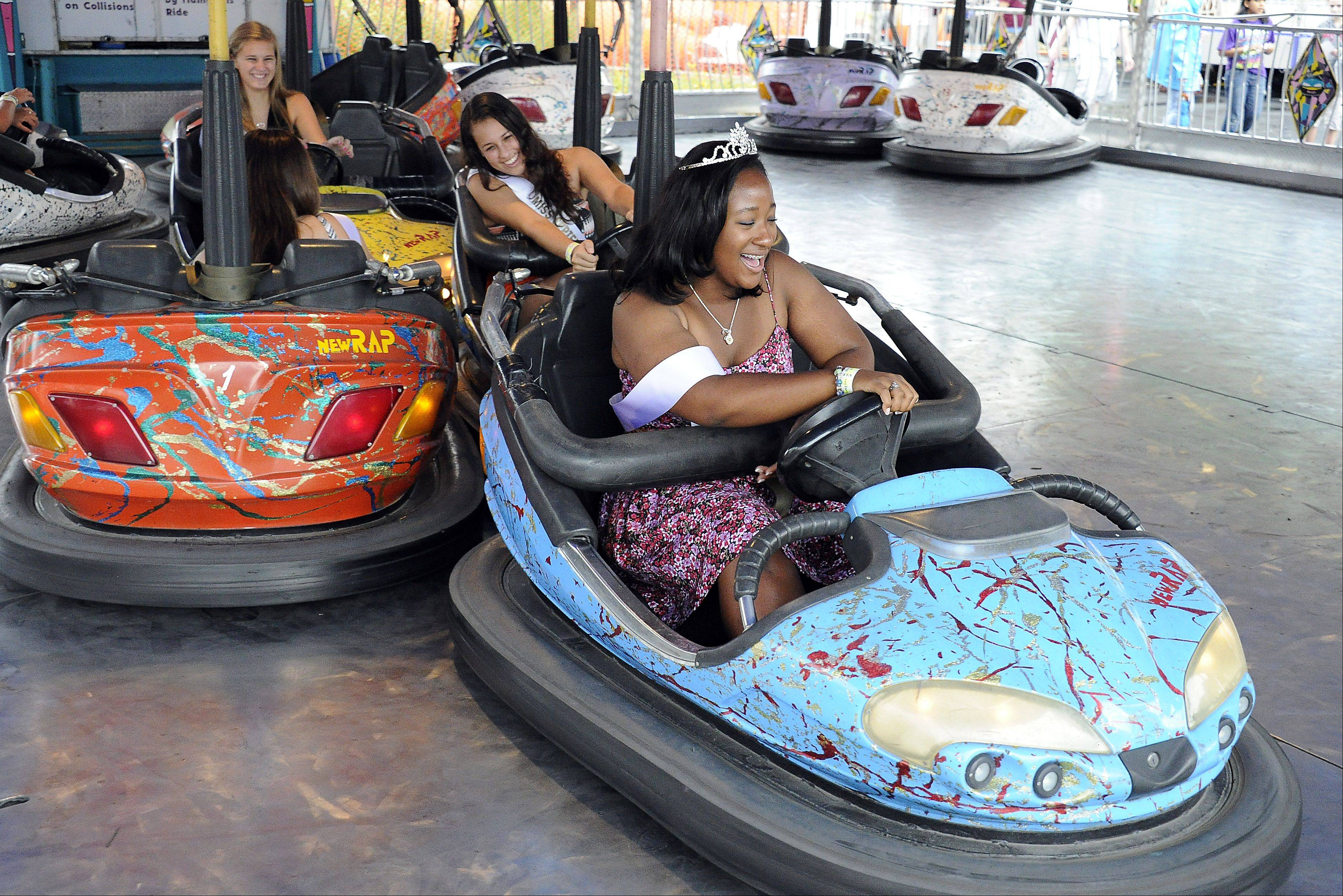 Miss Septemberfest Mariah Ghant, 17, of Schaumburg gets bumped by her friends as they ride the bumper cars at Septemberfest in Schaumburg on Saturday.