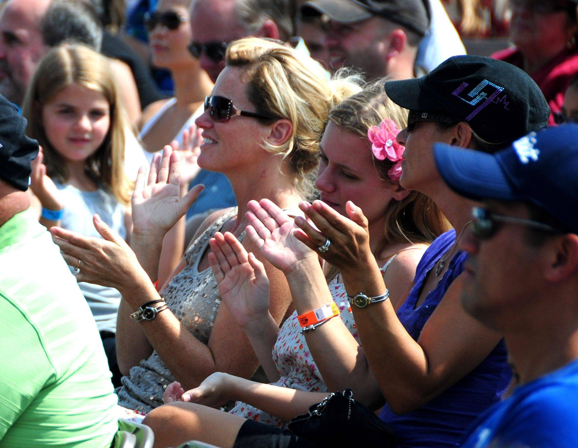 Crowd members applaud for a Dixie Chicks song during the Got Talent competition Sunday at the 12th annual Lake in the Hills Summer Sunset Fest at Sunset Park.