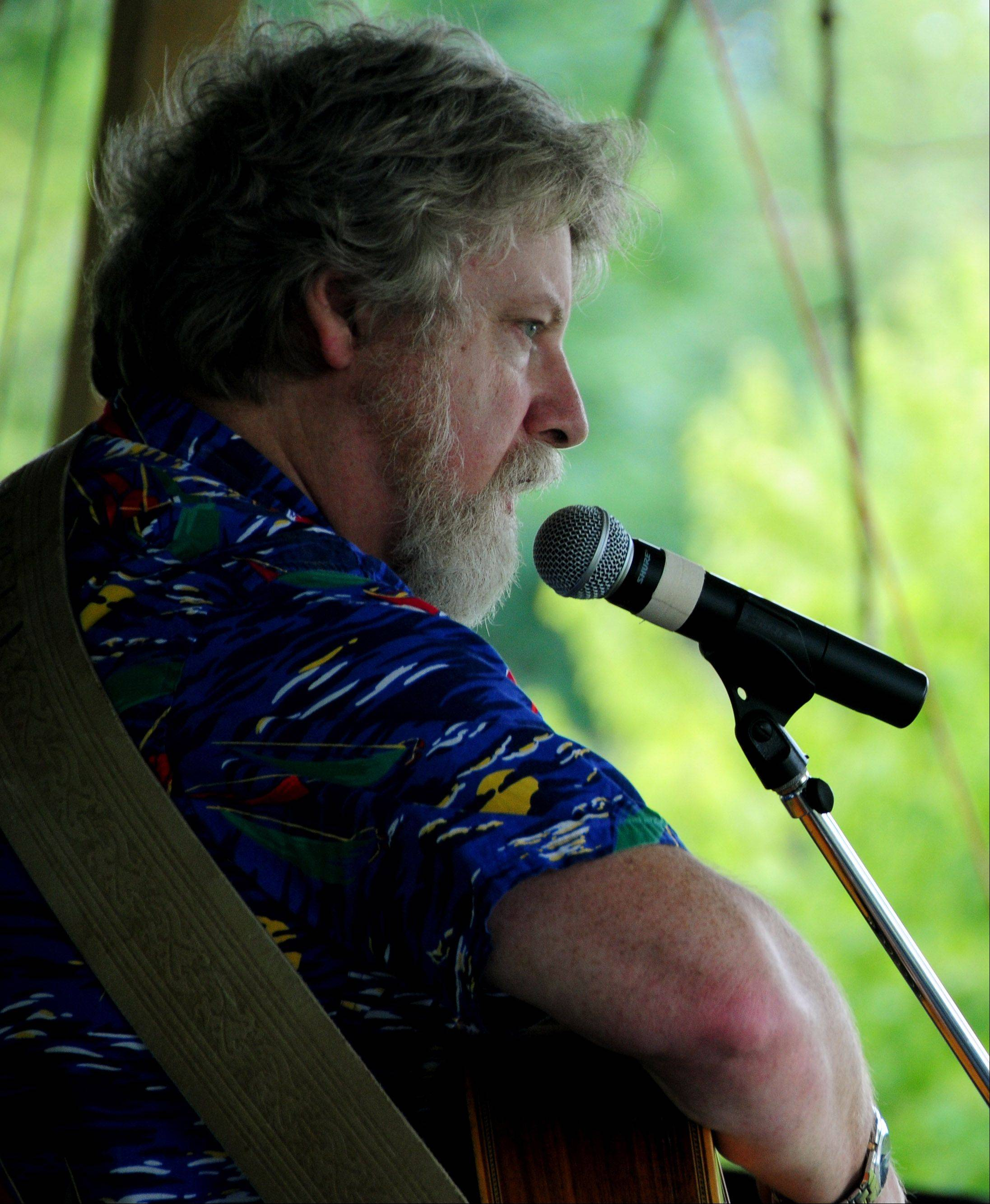 Lee Murdock plays the main stage at the 36th Annual Fox Valley Folk Music and Storytelling Festival at Island Park in Geneva Sunday.