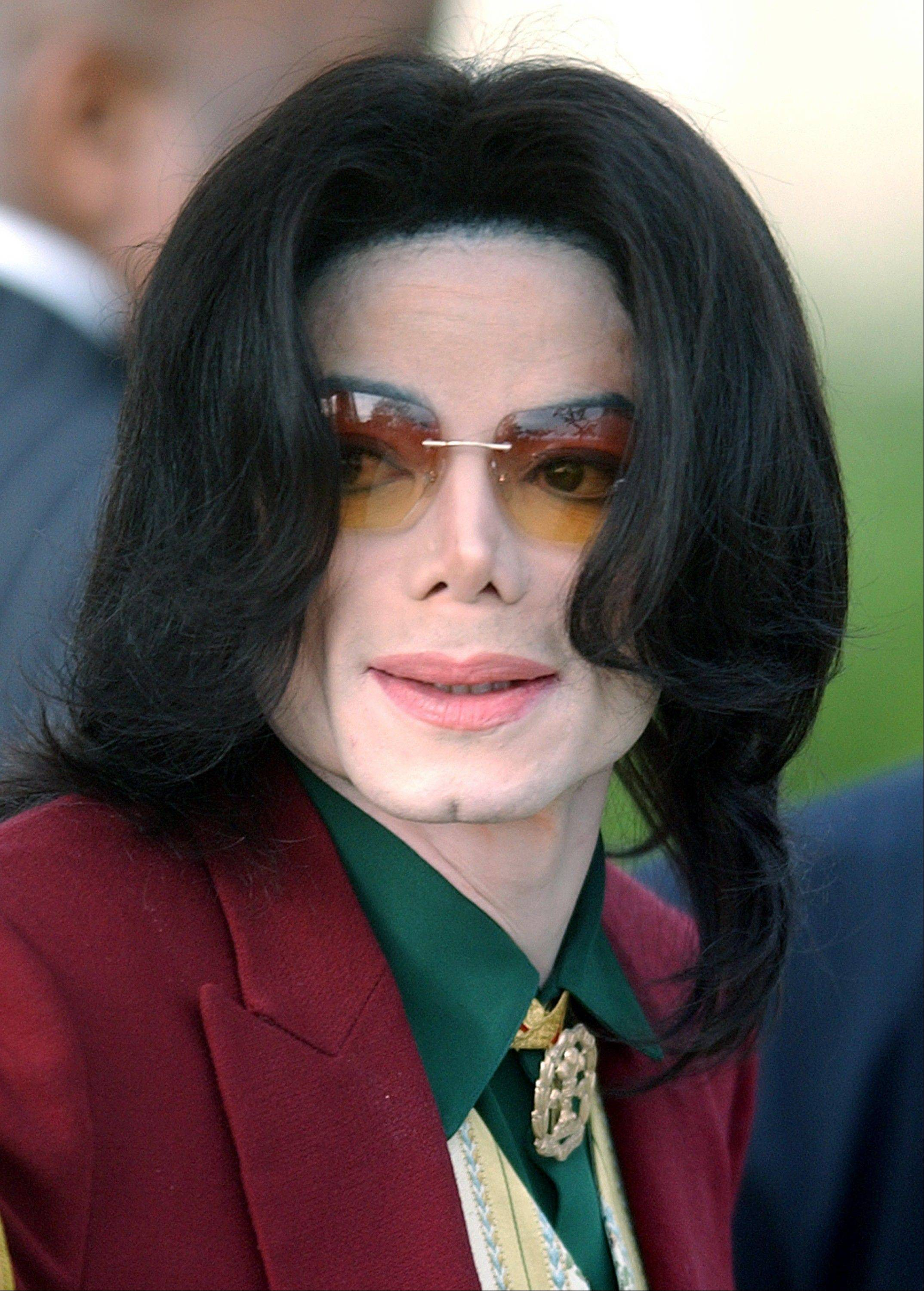 In this March 17, 2005, file photo, Michael Jackson arrives at the Santa Barbara County Courthouse in Santa Maria, Calif. Promoters of Jackson's planned 2009 comeback, described in emails released Saturday, Sept. 1, 2012, show they feared for the megastar's stability, saying he was out of shape and often consumed with self-doubt.