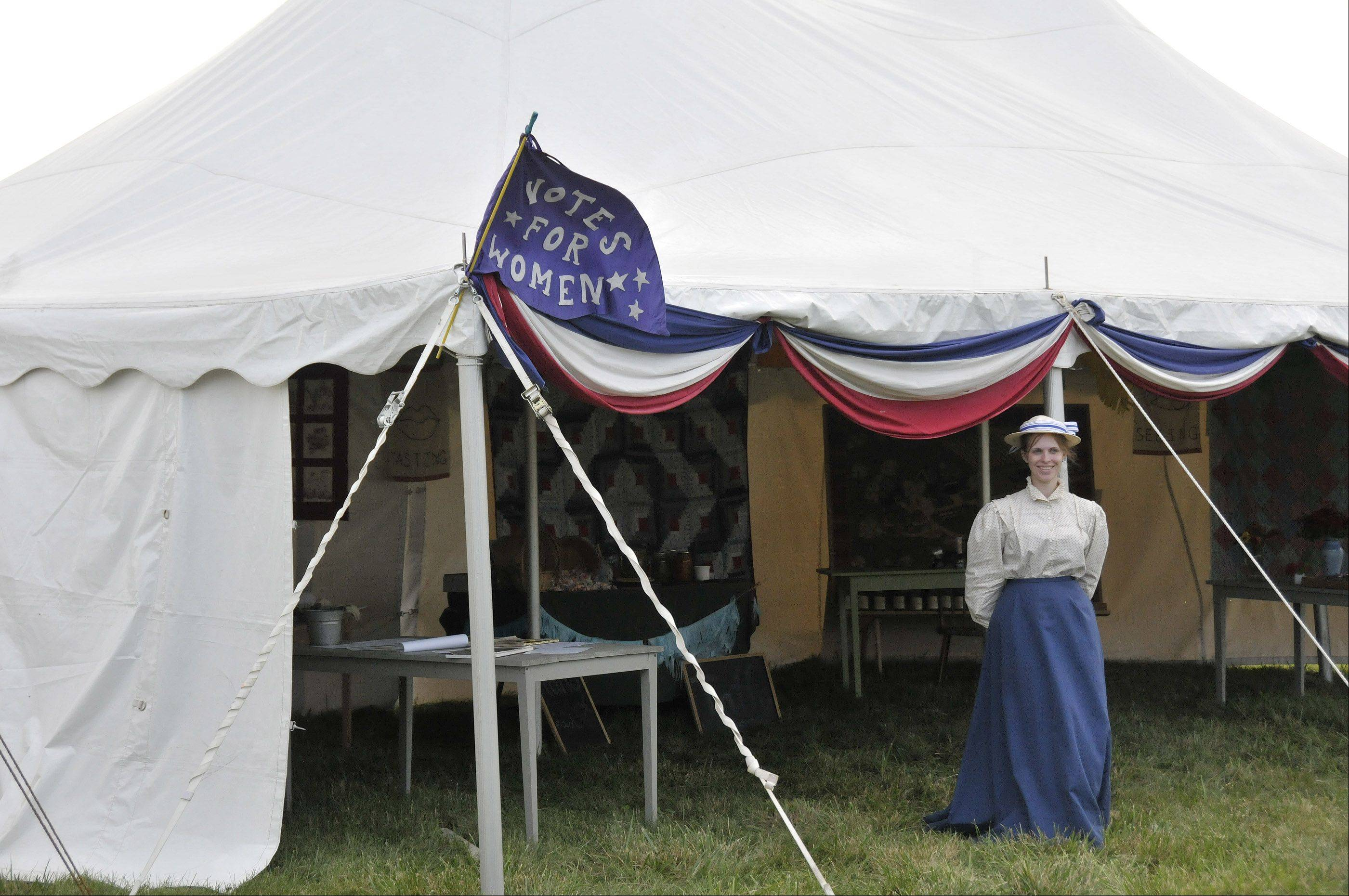 Kate Garrett, a heritage interpreter at Kline Creek Farm, waits for folks to stop by and see old-time snacks and other items during Sunday's old-fashioned country fair at the farm.