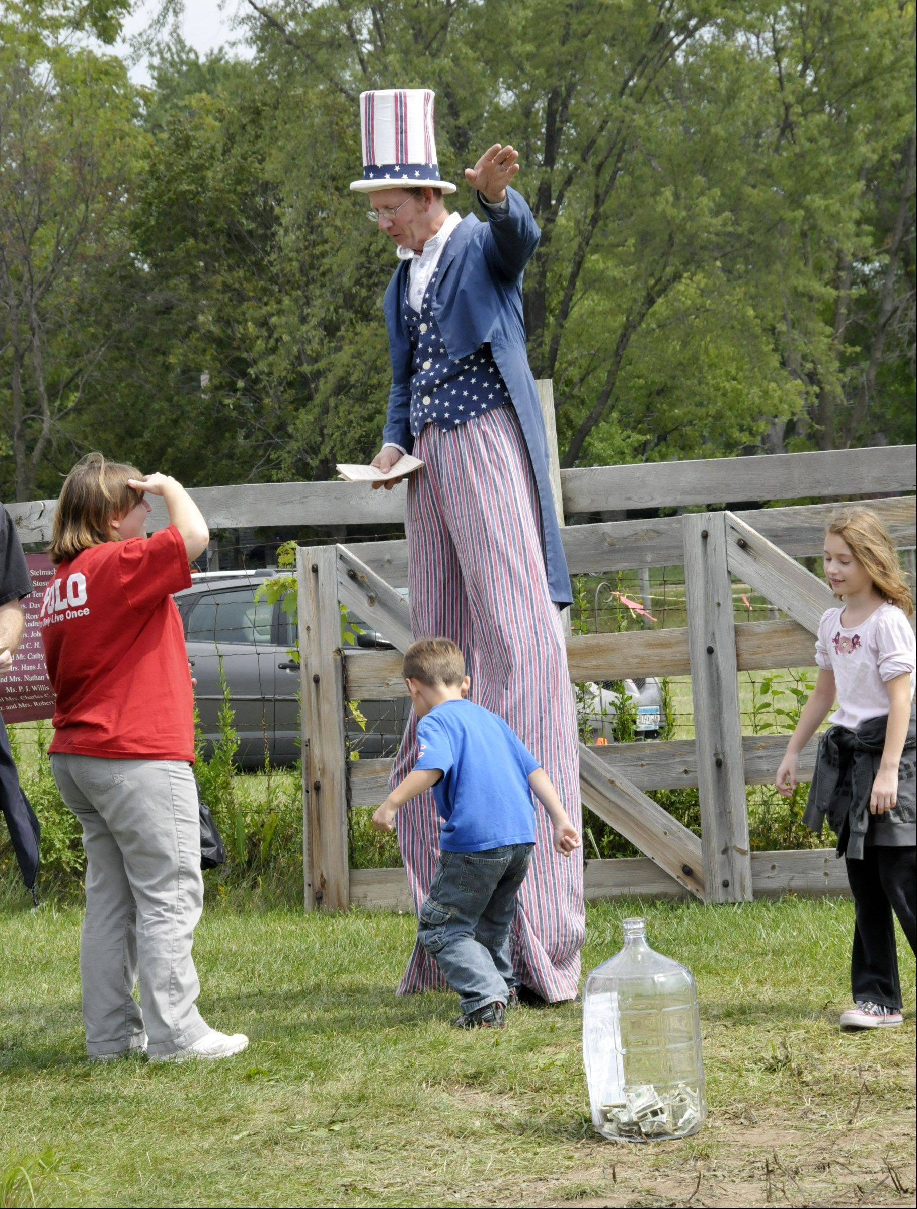 Keith McClow shows visitors around from a high vantage point during the DuPage County Forest Preserve District's old-fashioned country fair Sunday at Kline Creek Farm in West Chicago.