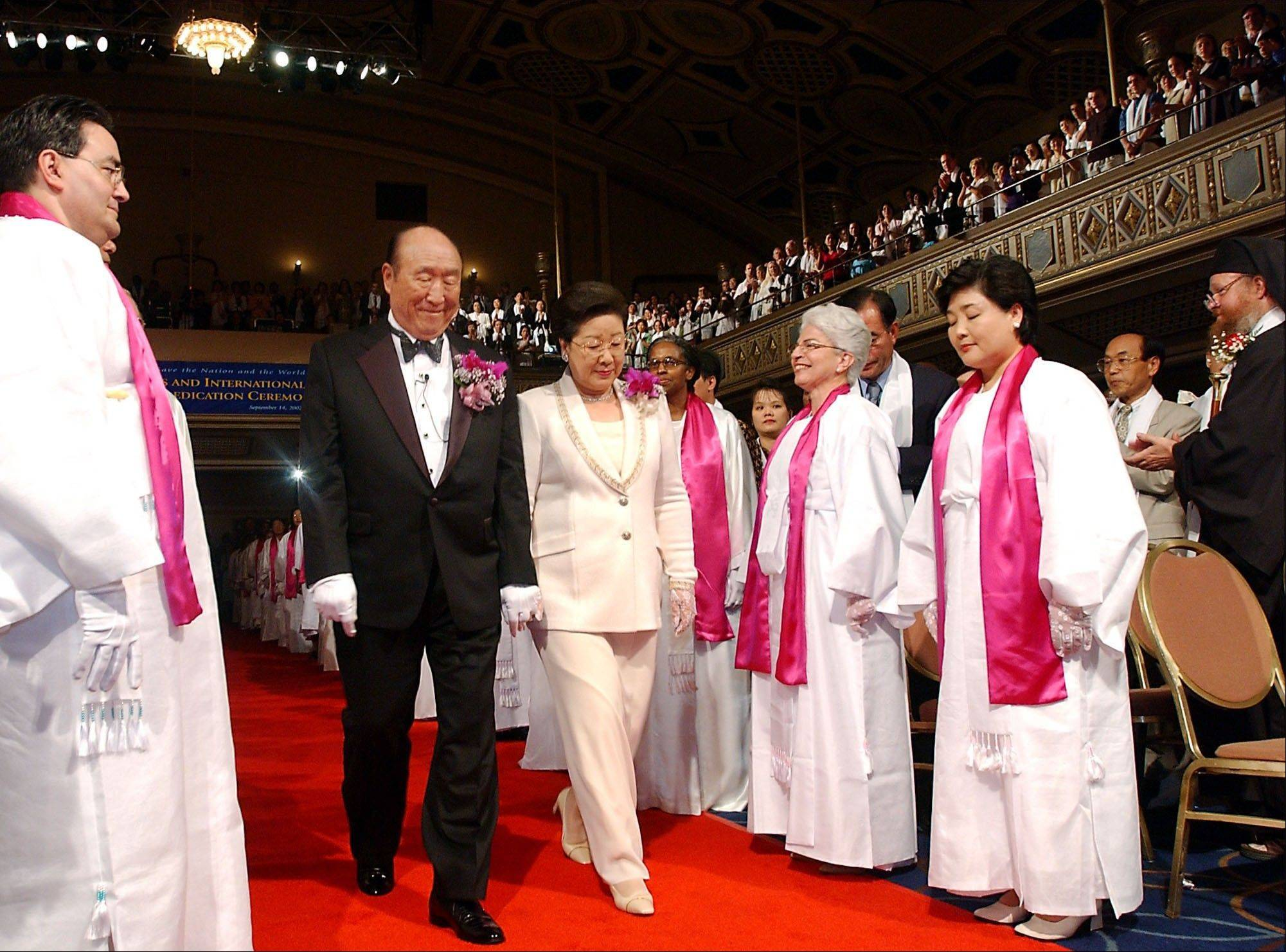 Rev. Sun Myung Moon, center left, and his wife, Hak Ja Han Moon, are introduced during the Affirmation of Vows part of the Interreligious and International Couple's Blessing and Rededication Ceremony at New York's Manhattan Center Sept. 14, 2002. About 500-600 couples participated in the New York ceremony and an estimated 21 million couples participated worldwide via a simulcast to 185 countries.