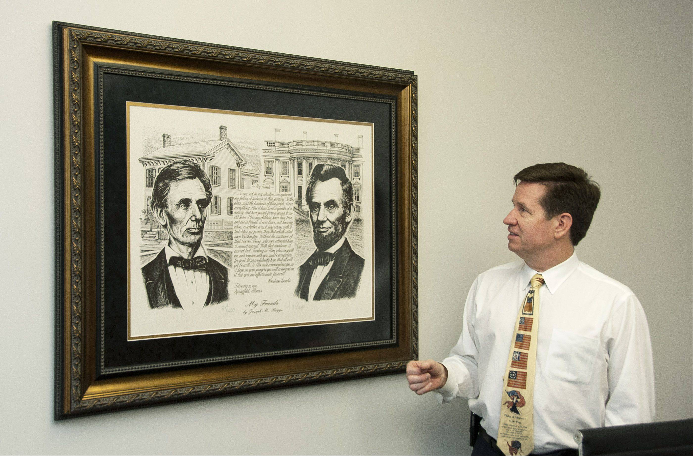 Lincoln authority and business owner Mickey Straub looks at a portrait of his hero, Abraham Lincoln, showing his evolution from Illinois lawyer to the first Republican president of the United States.