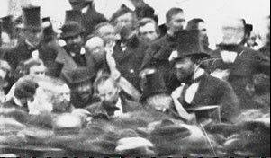 In this photograph from Nov. 19, 1863, a hatless President Abraham Lincoln stands in the crowd at Gettysburg.