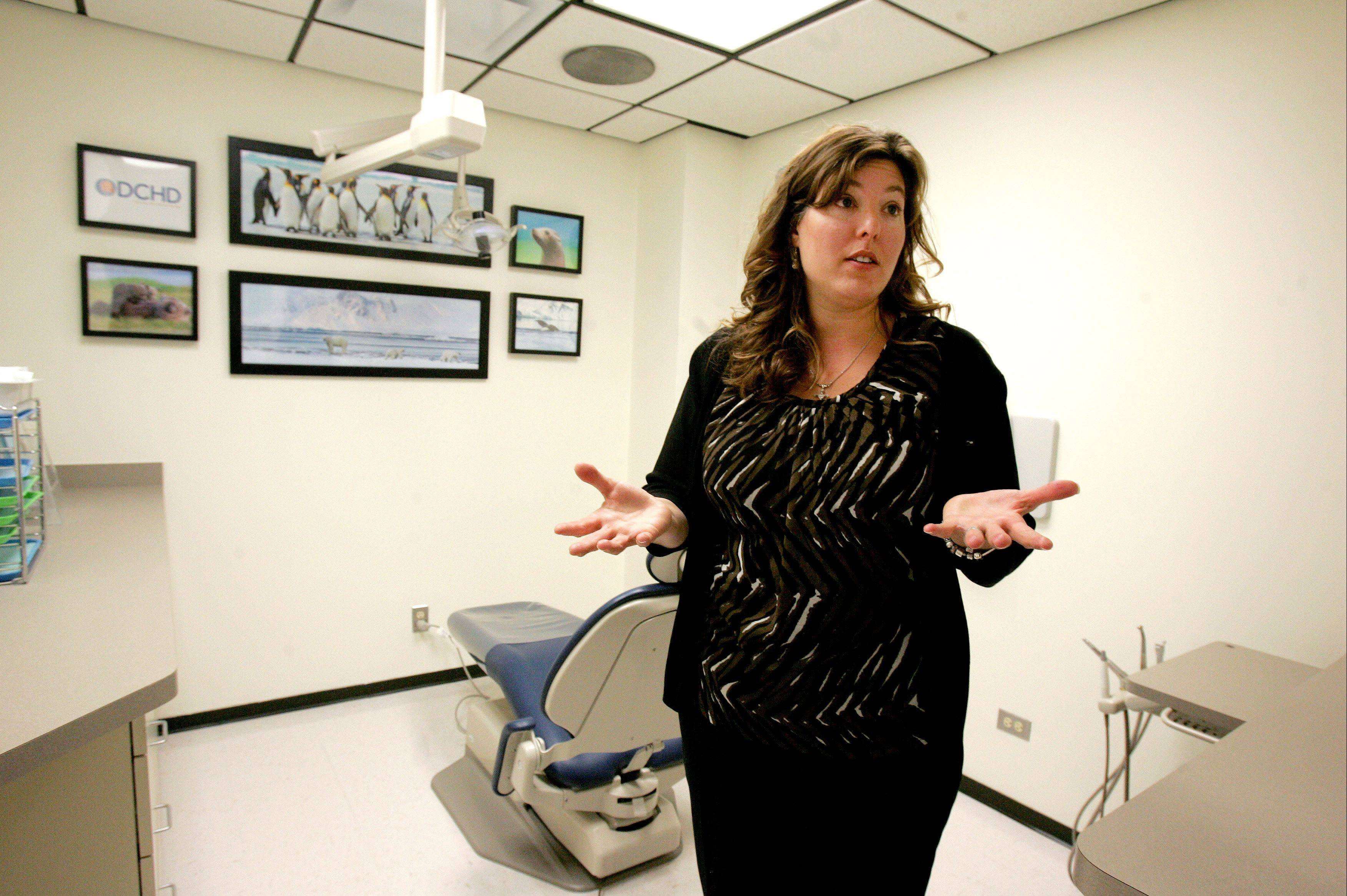 Mila Tsagalis, the DuPage County Health Department's assistant director of dental health, shows off one of the new treatment rooms at the expanded urgent care dental clinic in Wheaton. The number of treatment rooms at the clinic recently was increased from two to five.