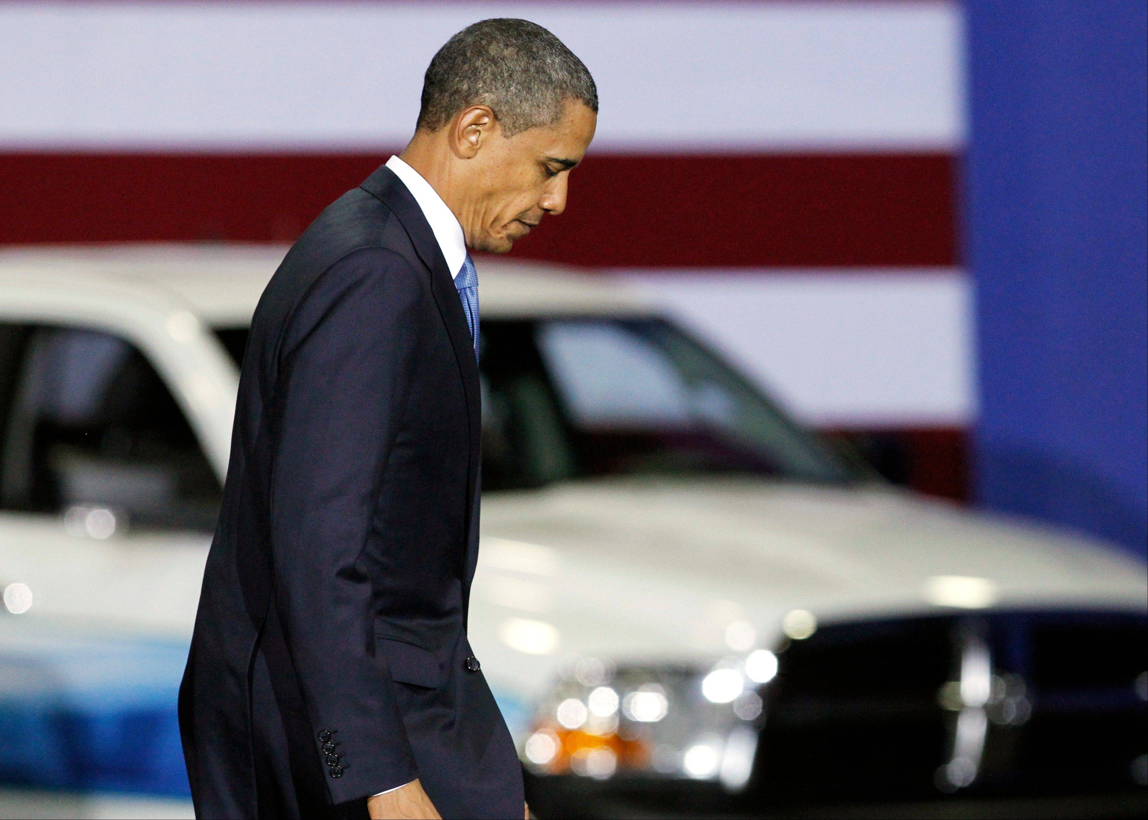 President Barack Obama walks down a ramp after delivering a speech at a gathering where he announced new fuel efficiency standards for cars and light trucks at the Washington Convention Center in Washington.