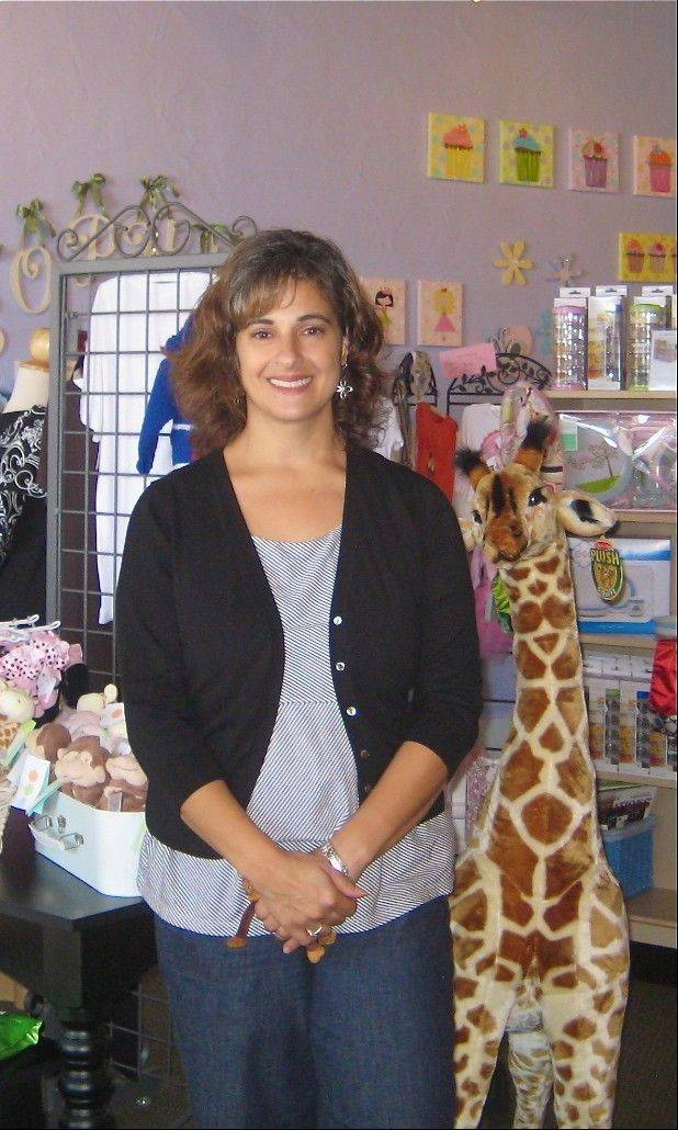 Kristina S. Garcia is the owner of Geneva-based Cradles & All Baby and Child