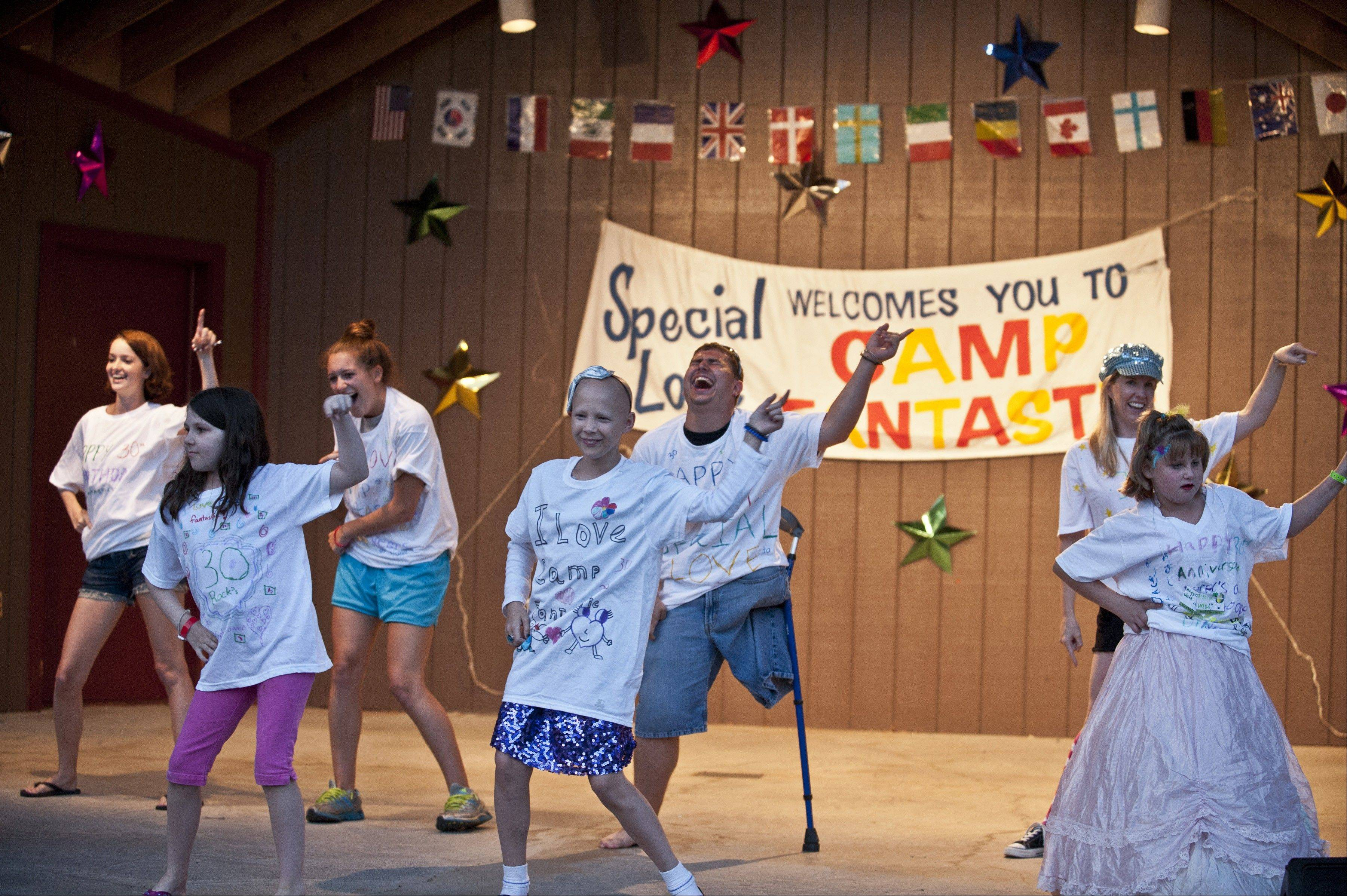 At Camp Fantastic in Front Royal, Va., Alesia Allen, 10, center, dances in front of counselor D.J. Conti during the talent show, which is a highlight of the weeklong getaway.