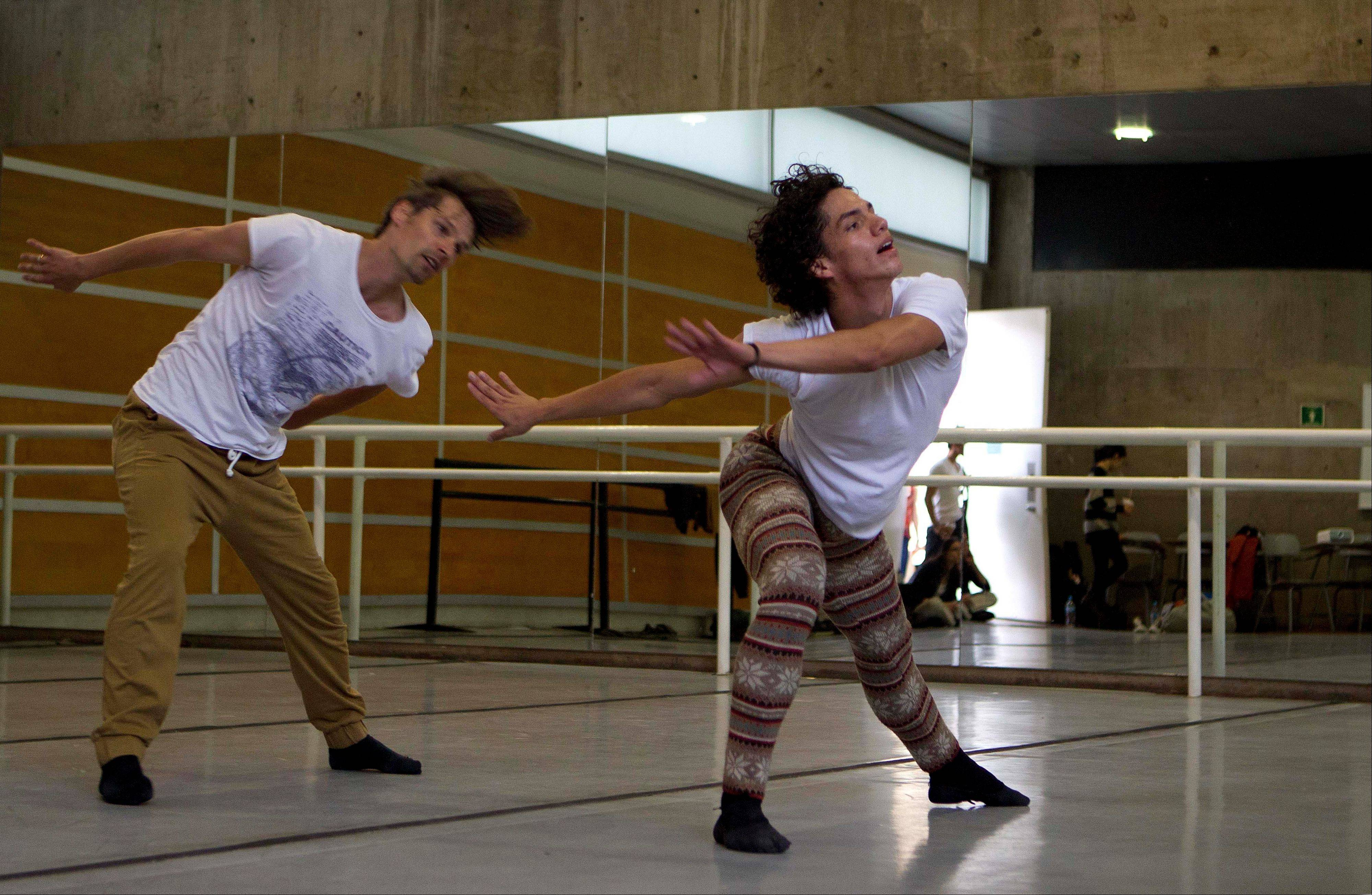 Isaac Hernandez, Mexico's most internationally acclaimed male ballet dancer, right, rehearses with ballet master Uwe Fisher-Pettitt in Mexico City.