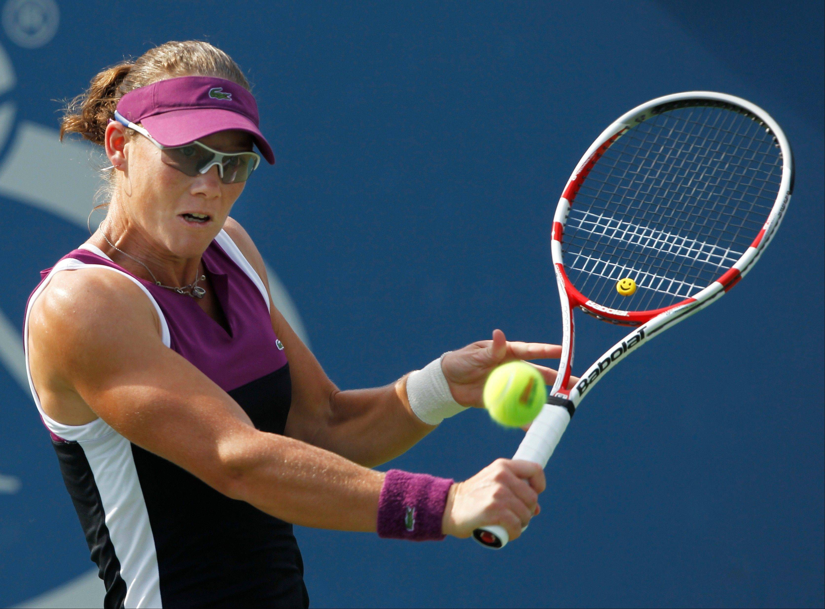 An Aug. 31, 2011 file photo shows Samantha Stosur of Australia returning a shot to Coco Vandeweghe during the U.S. Open tennis tournament in New York. The defending U.S. Open champion, Stosur is among the fittest women on the WTA tour.