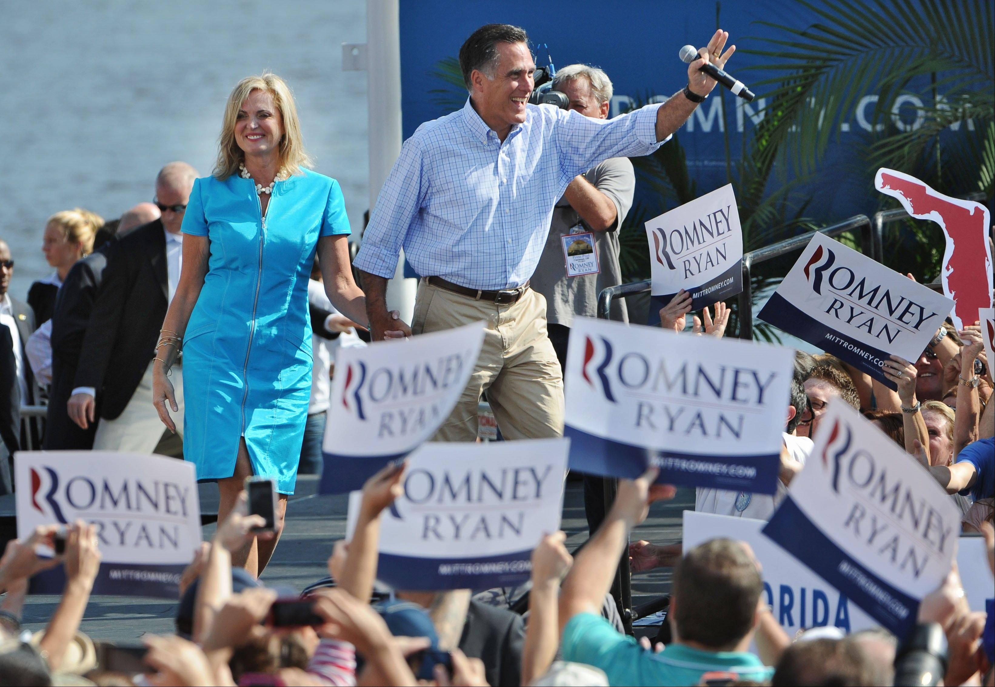 Republican presidential candidate, former Massachusetts Gov. Mitt Romney and his wife Ann take the stage Saturday for a campaign appearance in Jacksonville, Fla.