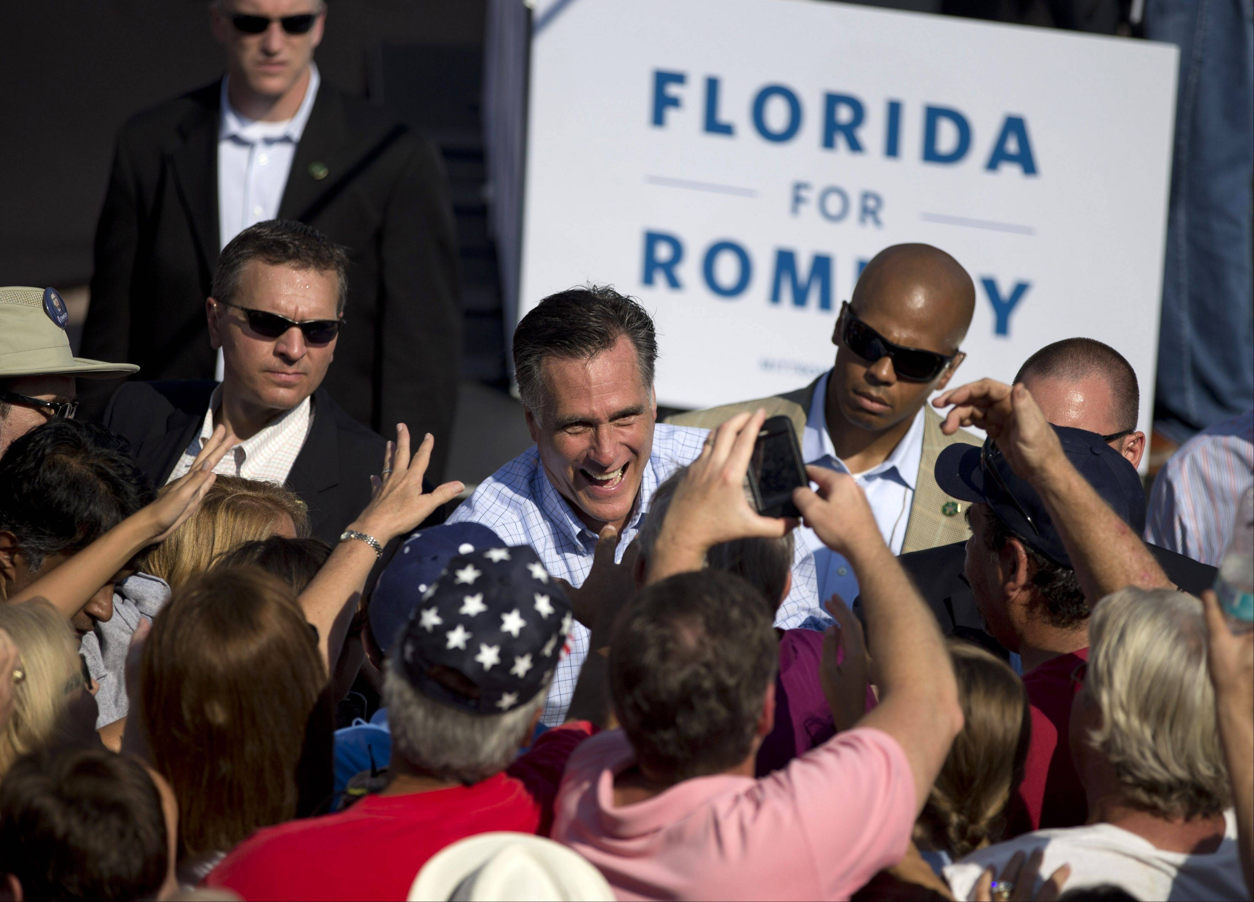 Republican presidential candidate, former Massachusetts Gov. Mitt Romney shakes hands during a campaign rally, Saturday, Sept. 1, 2012, in Jacksonville, Fla.