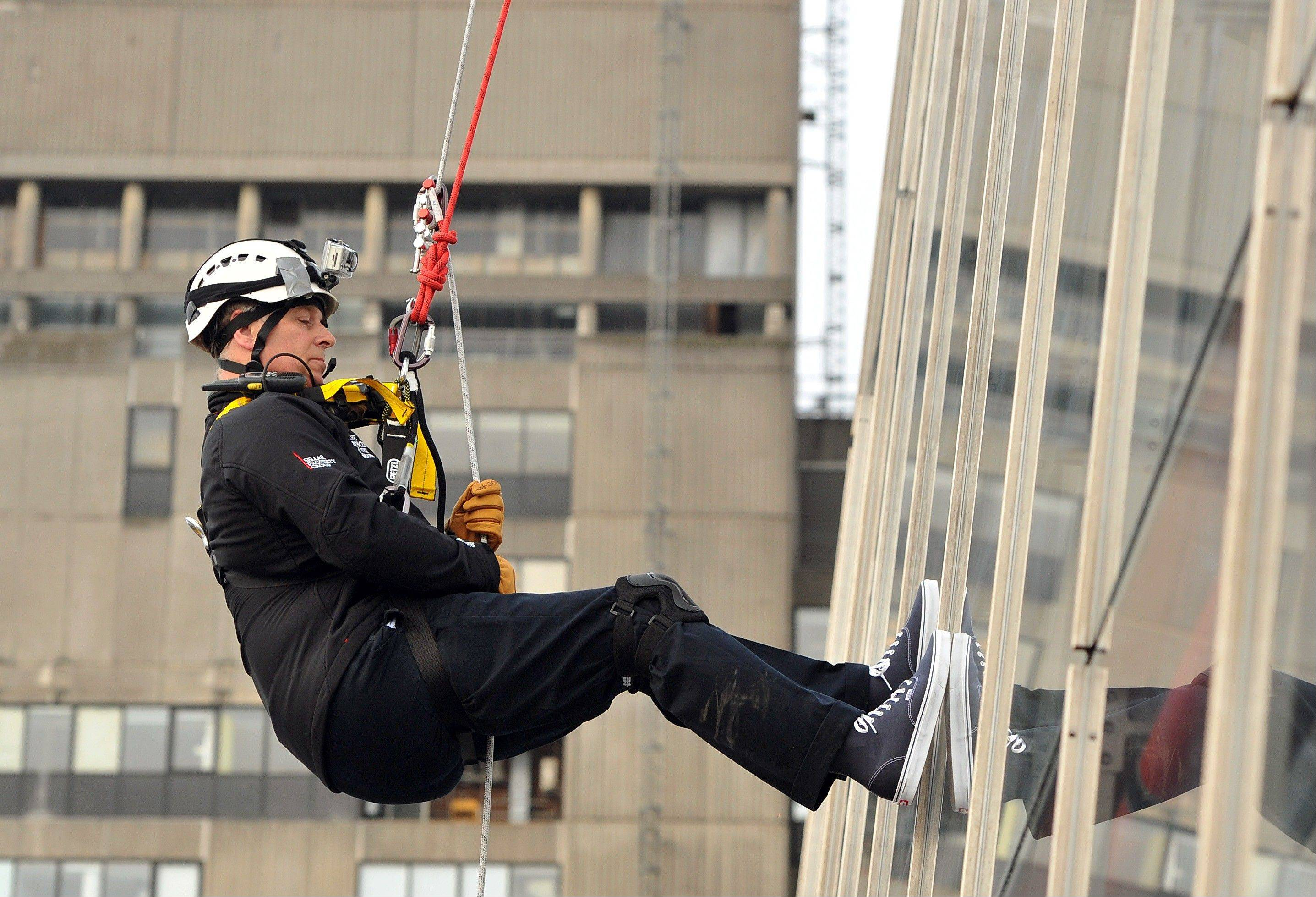 Britain's Prince Andrew abseils down The Shard, the tallest building in Europe, for charity in central London Monday, Sept. 3, 2012. The 52-year-old royal descended the Shard skyscraper in London, beginning his daredevil stunt from the 87th floor - just below the top of the 1,016ft tower - and finishing half an hour later on level 20.