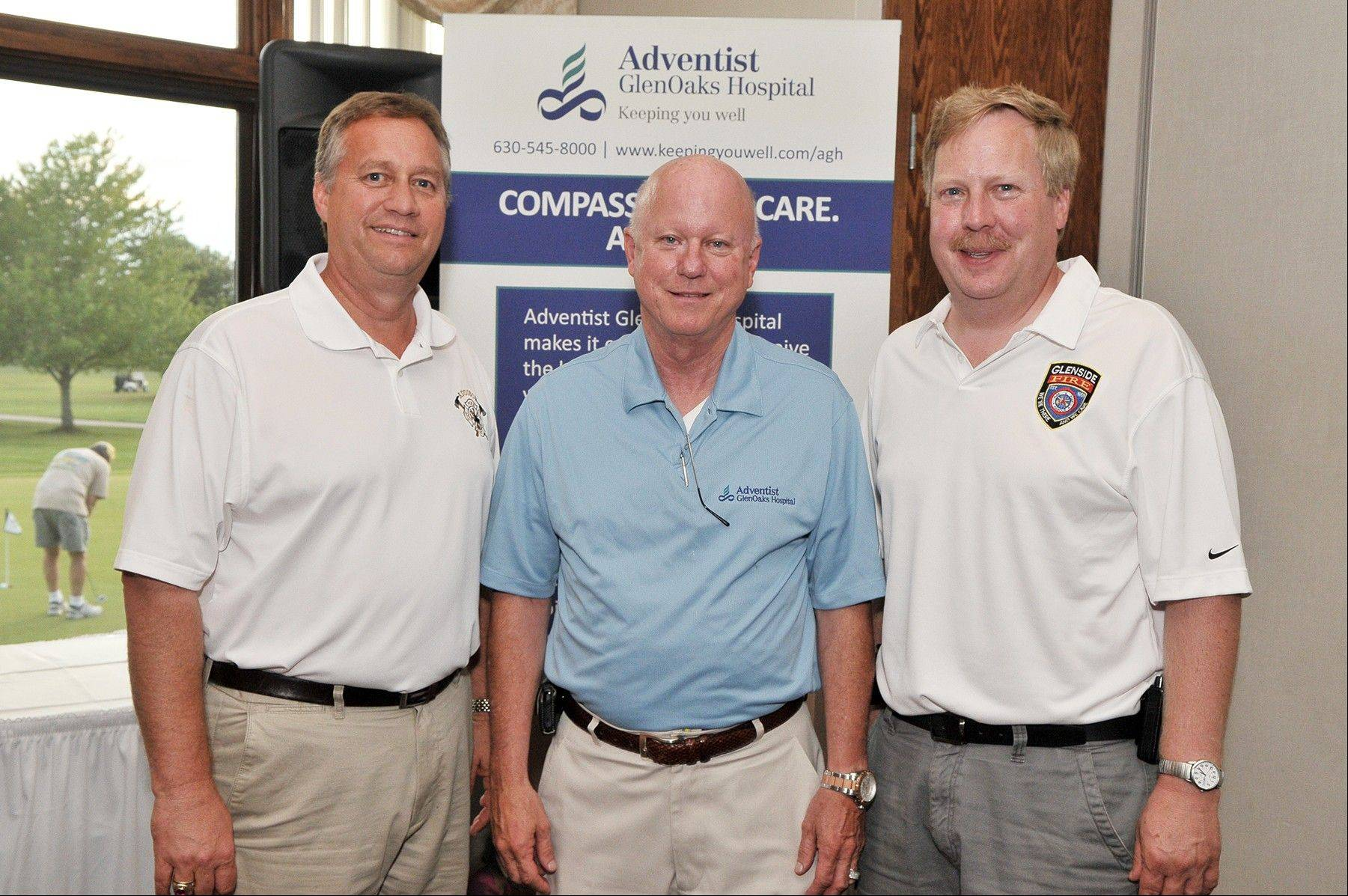 Addison Fire Protection District Chief Don Markowski, left, Adventist GlenOaksHospital CEO Bruce C. Christian, and Glenside Fire Protection District Chief Russ Wood attended the hospital's annual EMS Appreciation Golf Outing in Glendale Heights.